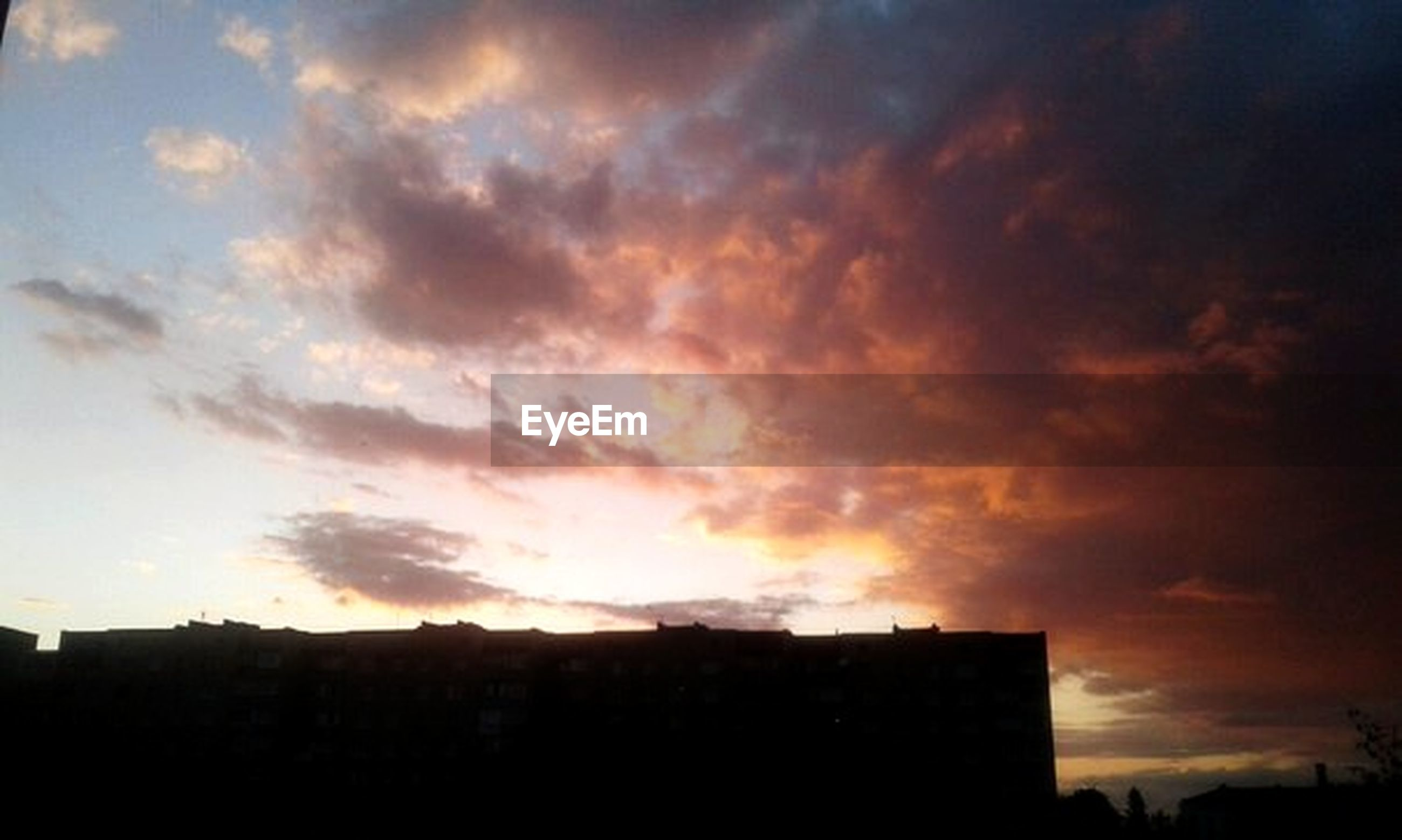 sunset, silhouette, sky, building exterior, architecture, built structure, cloud - sky, cloud, cloudy, orange color, low angle view, beauty in nature, scenics, city, nature, dramatic sky, outdoors, house, building, no people