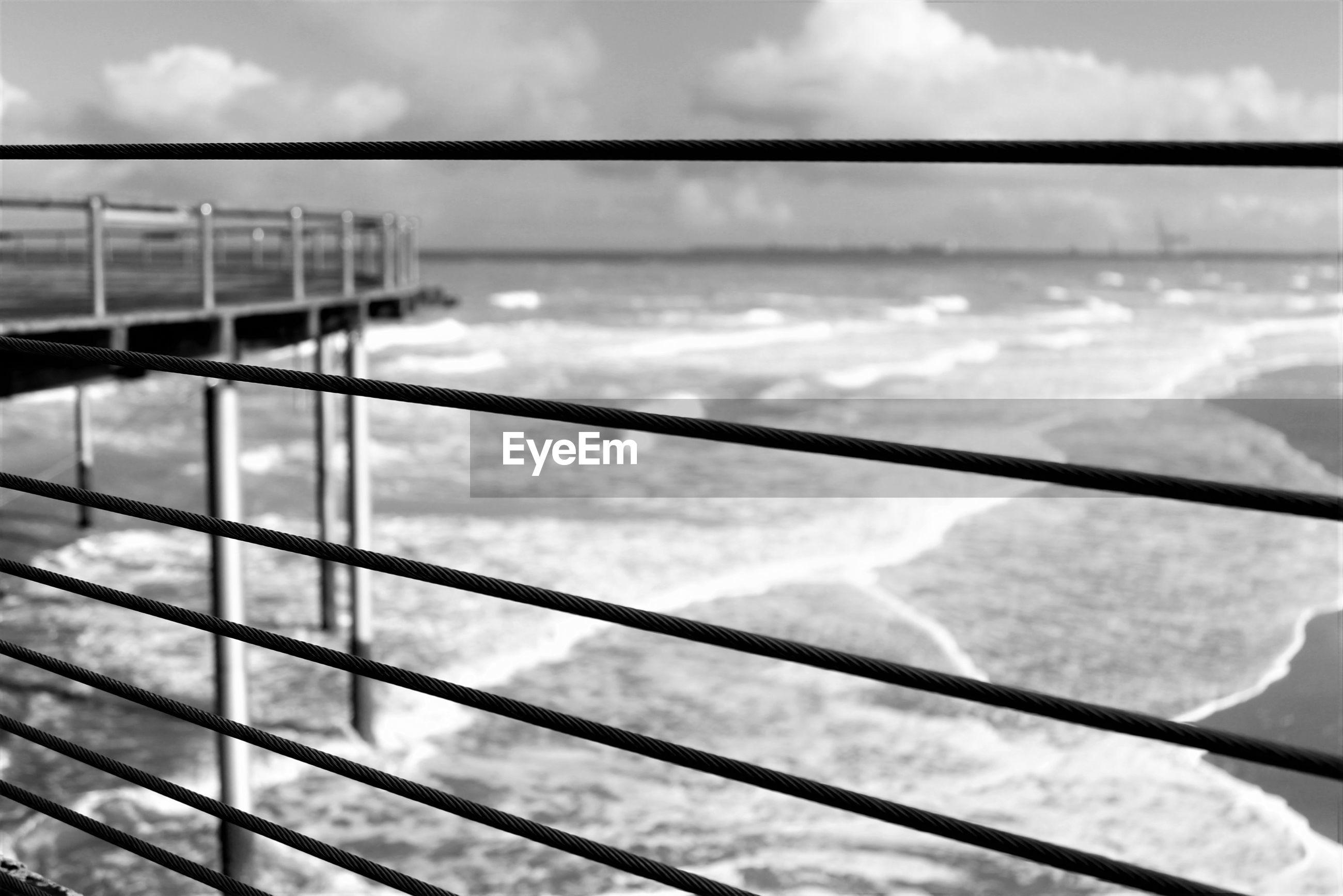 Pier over sea seen from window