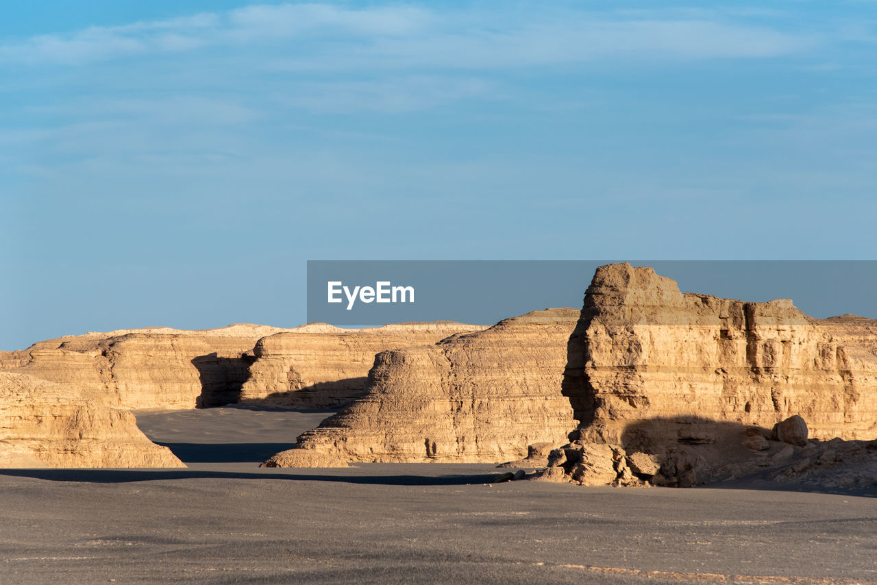 sky, rock, beauty in nature, rock formation, rock - object, scenics - nature, tranquil scene, solid, nature, tranquility, non-urban scene, physical geography, geology, no people, remote, land, sunlight, day, travel destinations, environment, outdoors, arid climate, climate, eroded, formation