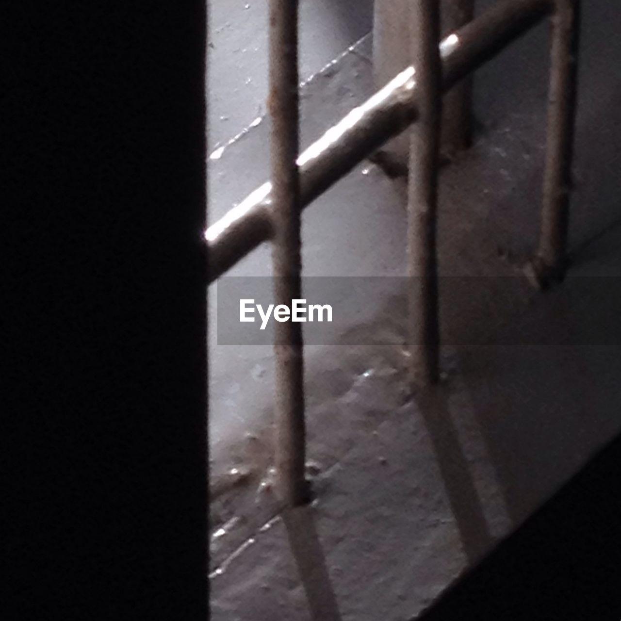 metal, no people, close-up, door, shadow, indoors, sunlight, day, security bar