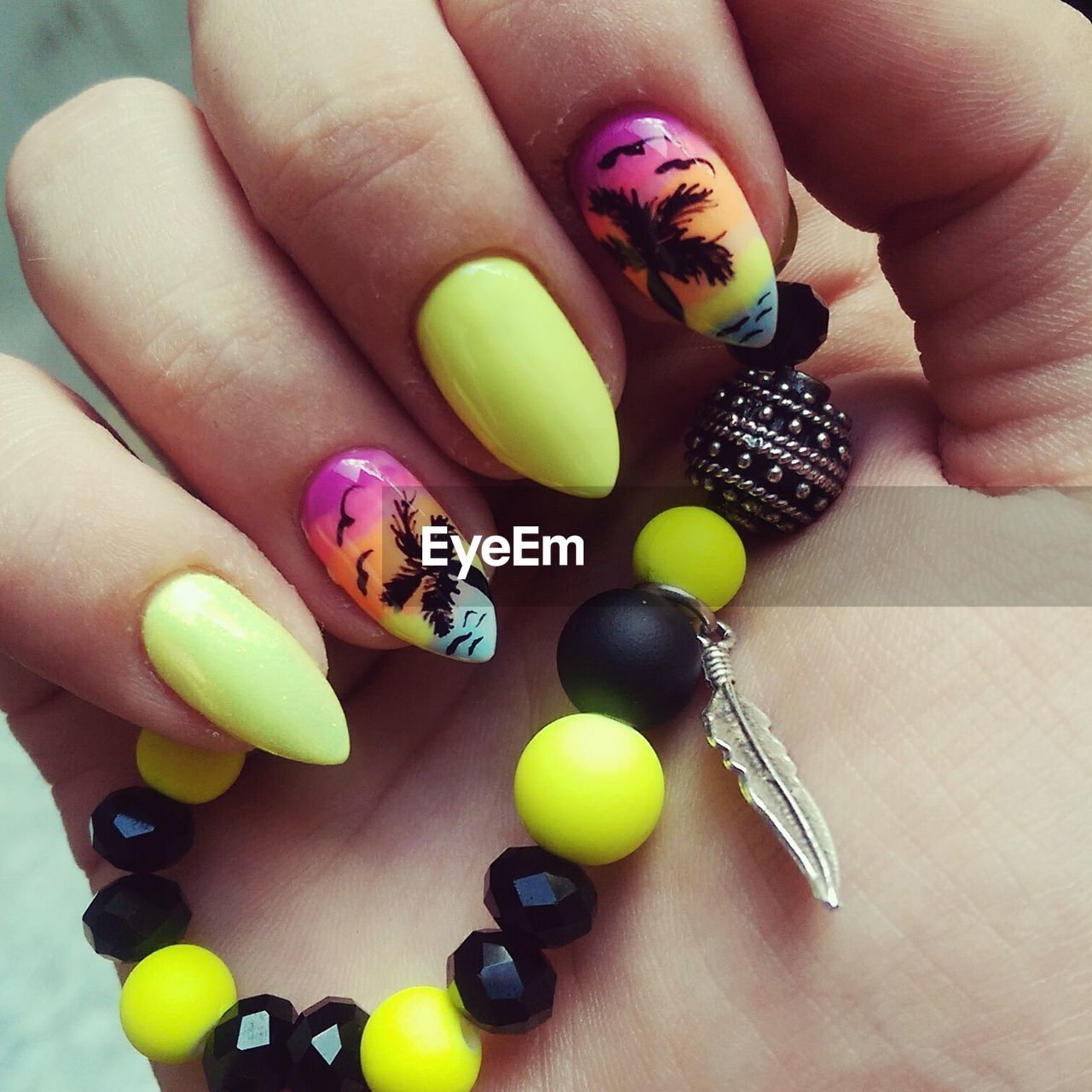 Close-Up Of Human Hand With Painted Nails