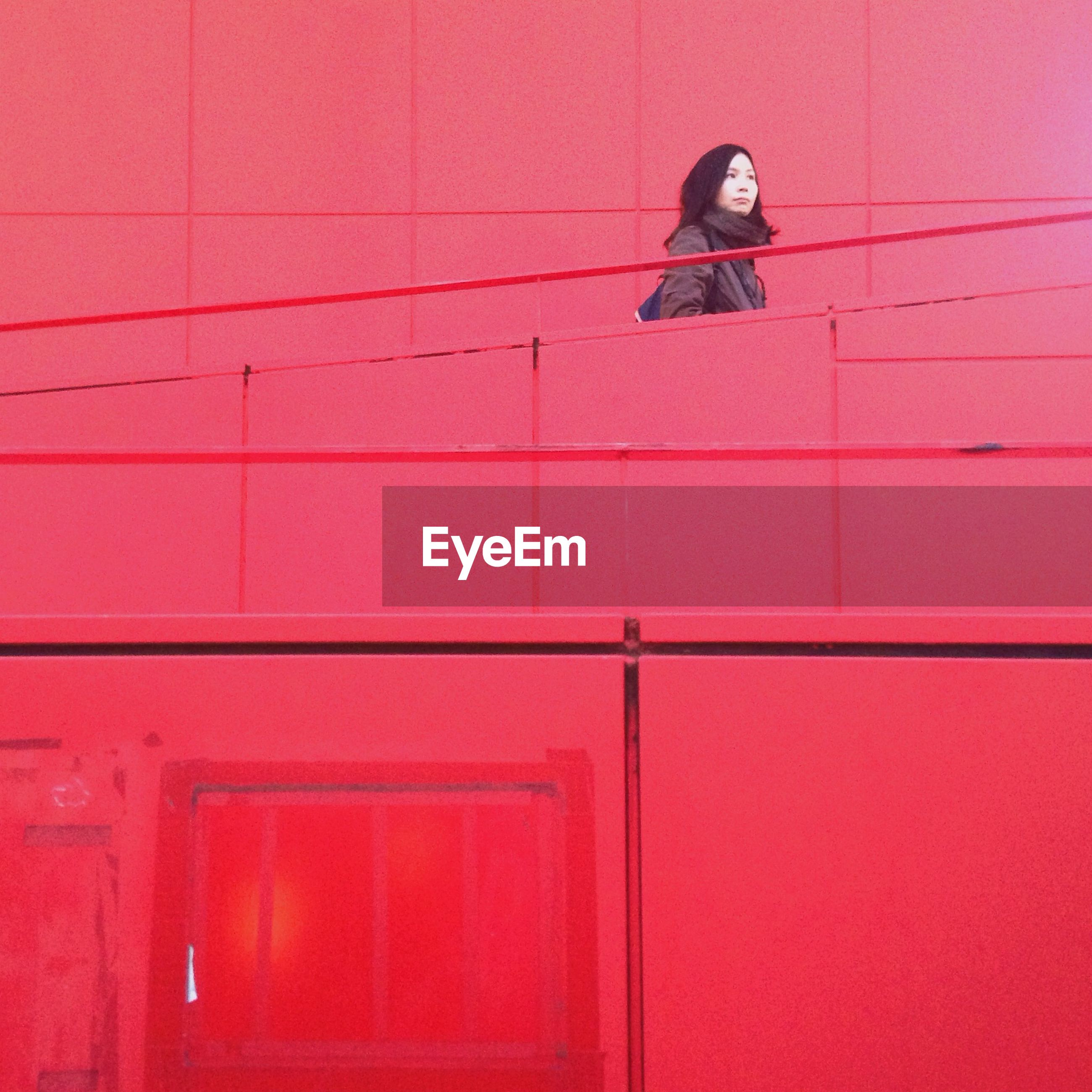Woman on red stairway