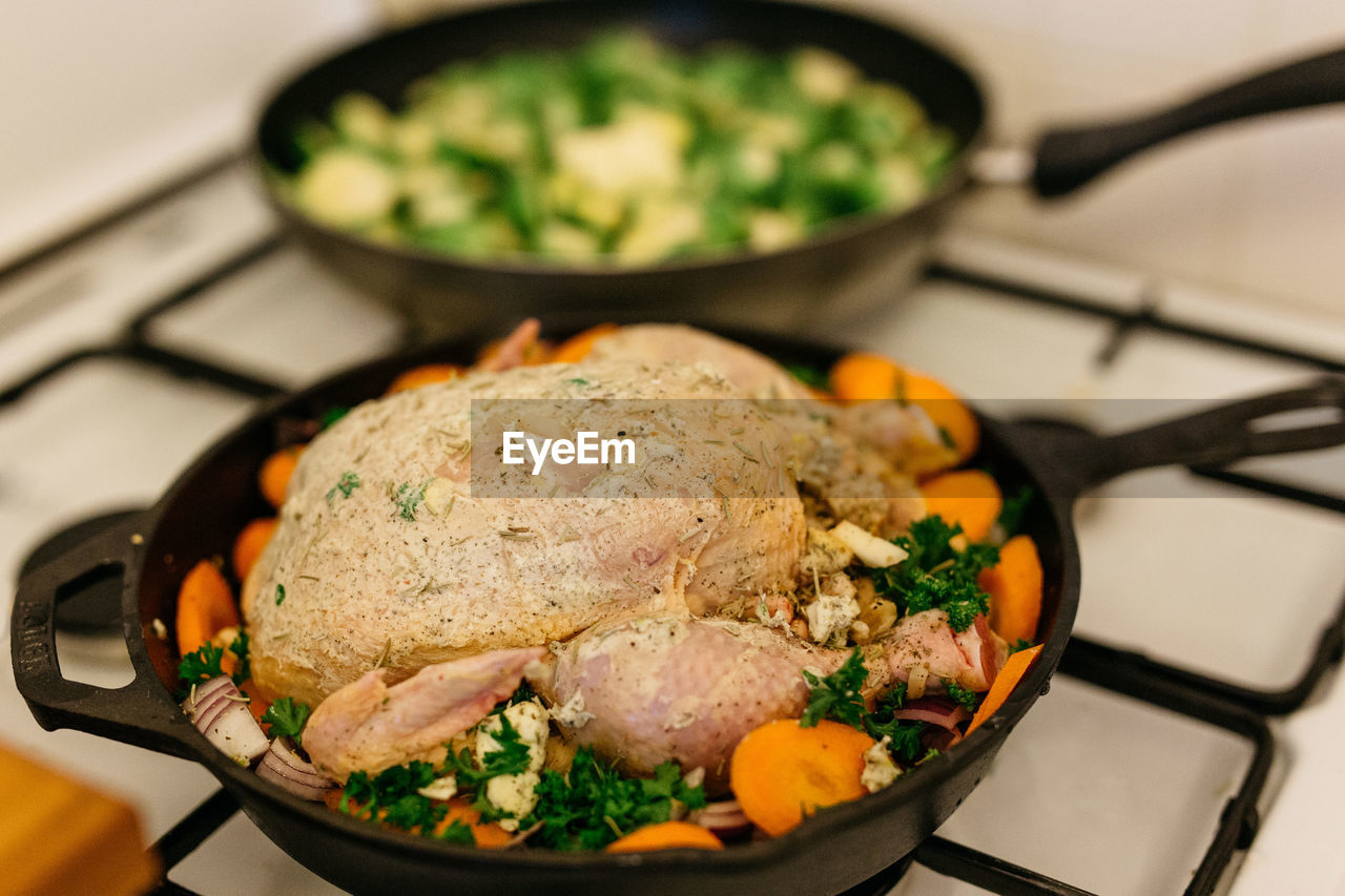 High Angle View Of Meat And Vegetables In Frying Pan