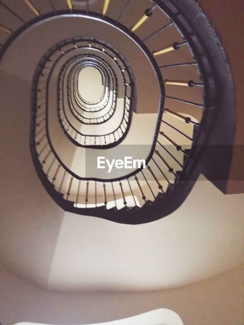 staircase, steps and staircases, spiral, spiral stairs, steps, railing, stairs, architecture, design, built structure, hand rail, no people, high angle view, indoors