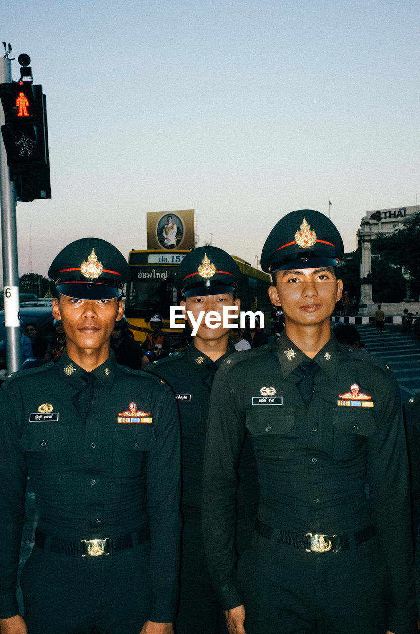 uniform, real people, looking at camera, portrait, heroes, protection, safety, standing, police uniform, waist up, mid adult men, military uniform, cap, occupation, young adult, police force, armed forces, front view, authority, men, young men, law, outdoors, day, young women, firefighter, army soldier, military, adult, people