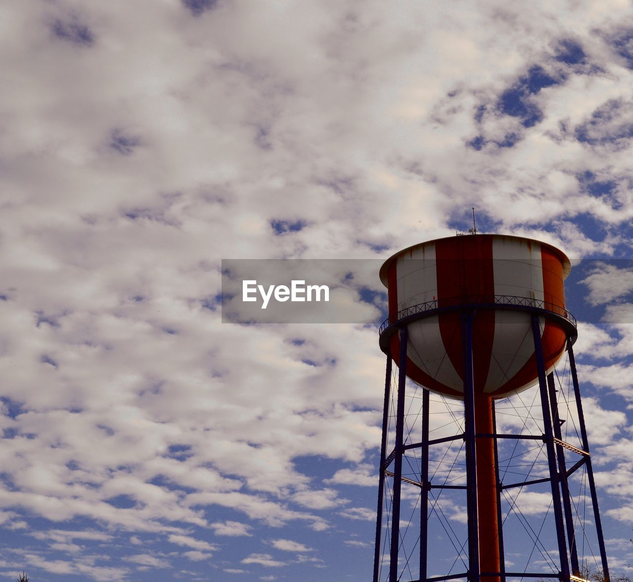 cloud - sky, sky, low angle view, water tower - storage tank, architecture, built structure, tower, storage tank, nature, no people, water conservation, day, outdoors, building exterior, tall - high, safety, guidance, amusement park, security