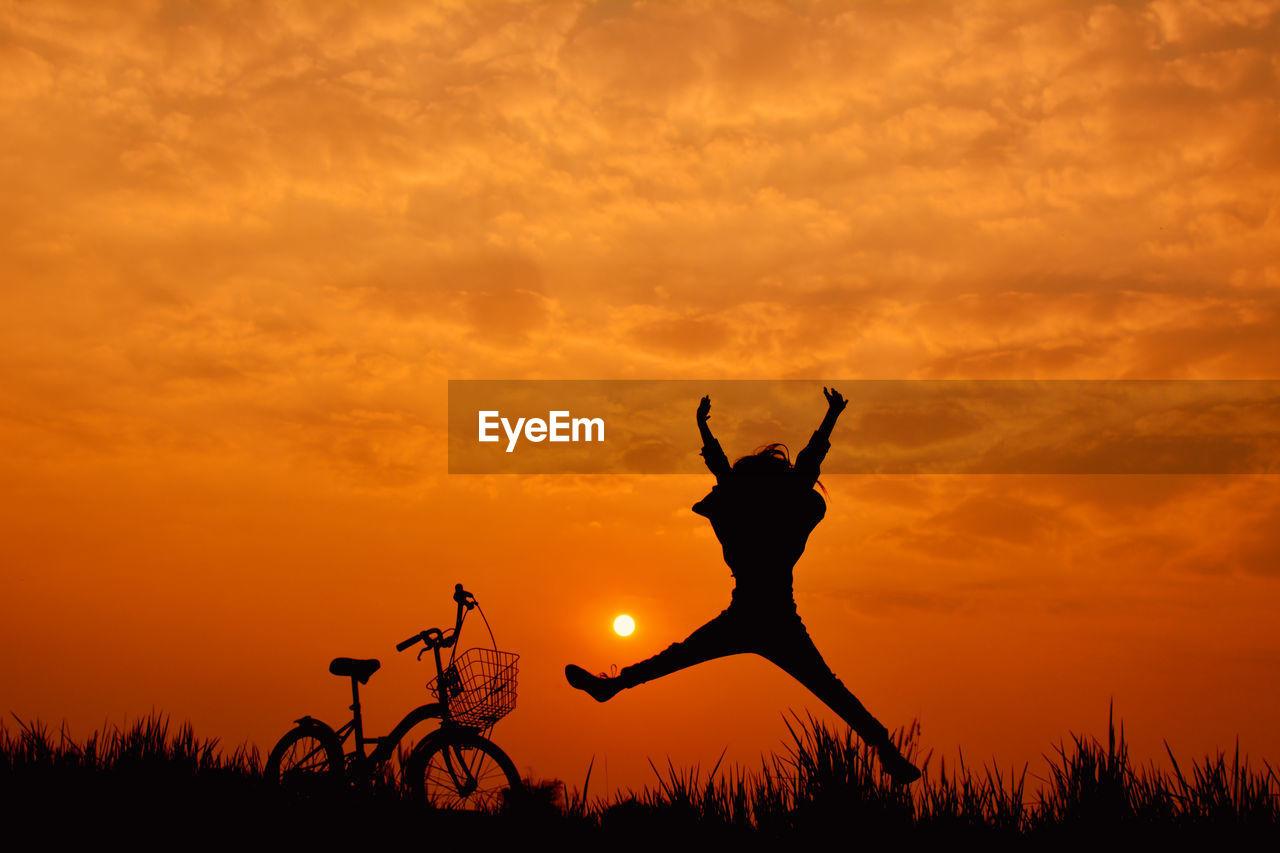 Silhouette Of Person Against Orange Sky