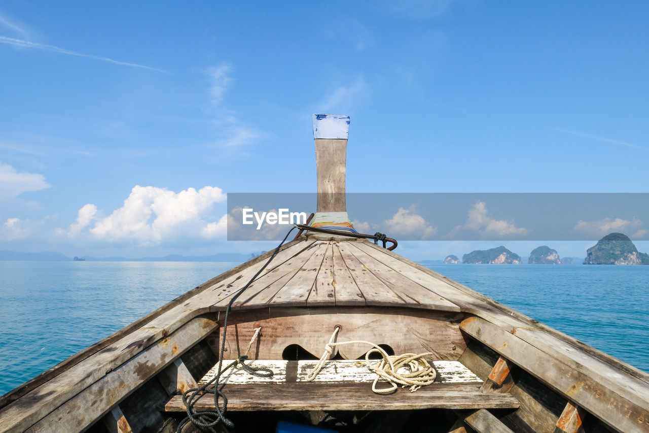water, sky, sea, cloud - sky, nautical vessel, nature, day, no people, architecture, scenics - nature, built structure, wood - material, mode of transportation, transportation, beauty in nature, sunlight, blue, outdoors, travel, horizon over water