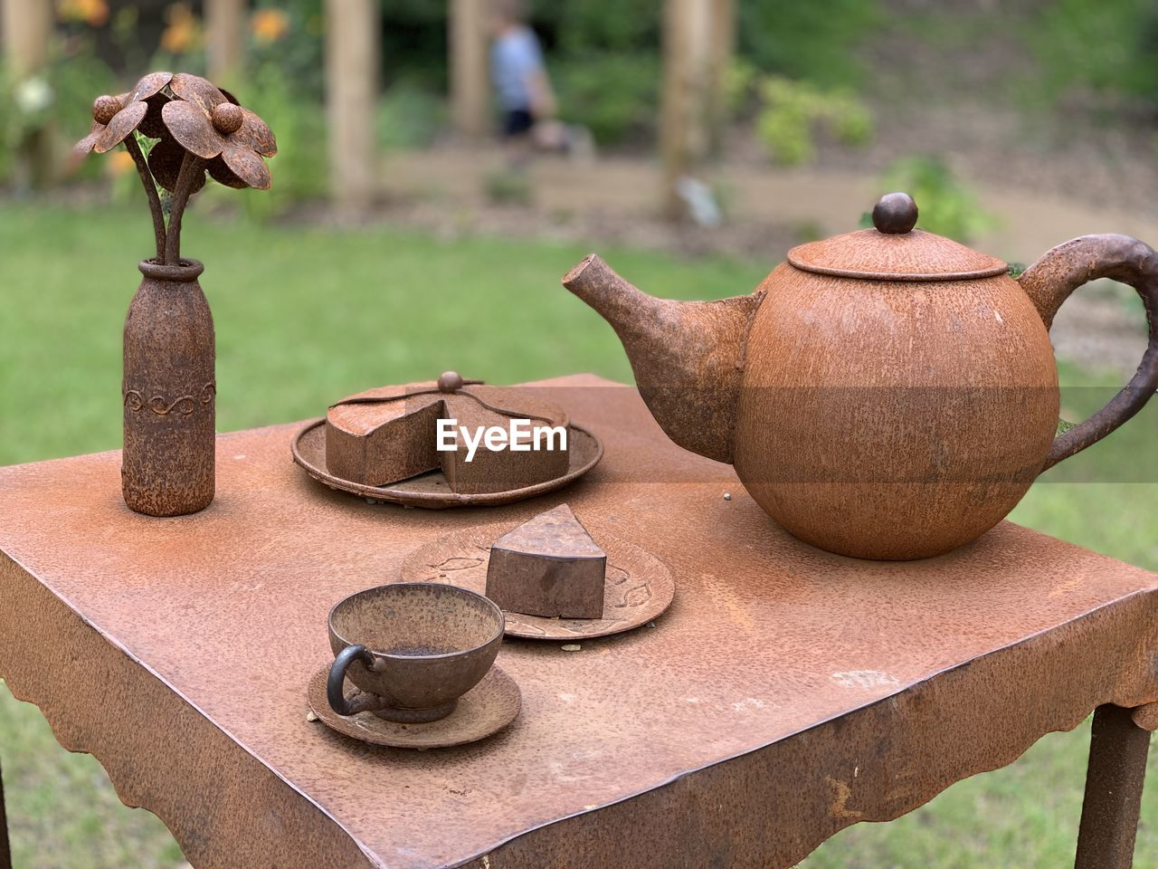 Close-up of wooden handicrafts on table at yard