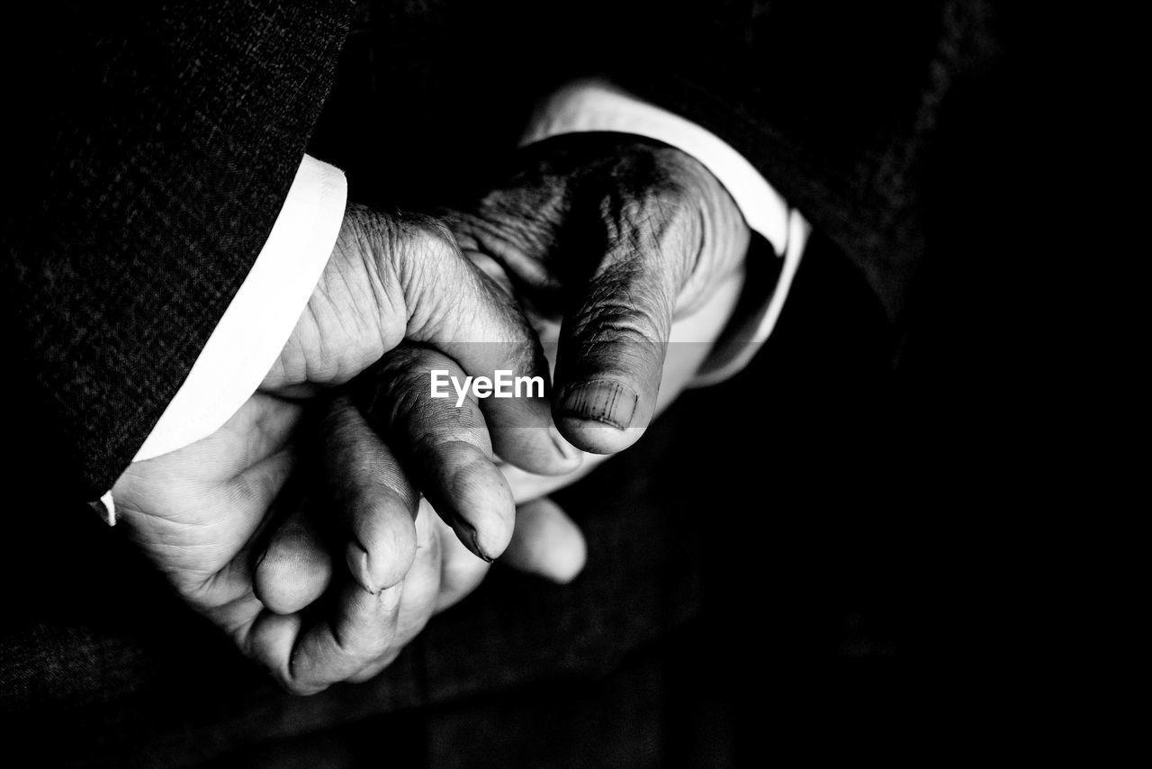Close-up of man hands against black background