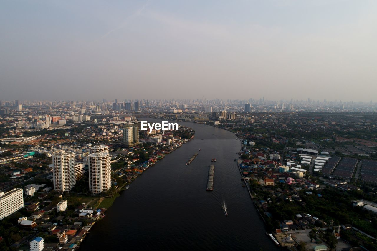 High angle view of city with river