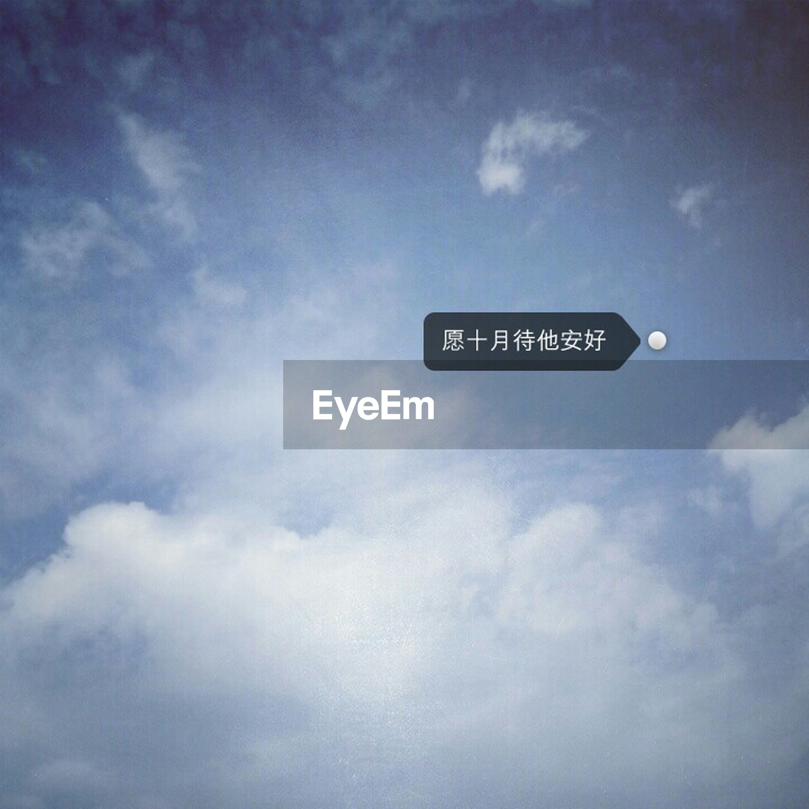 text, western script, communication, sky, sign, low angle view, information sign, guidance, cloud - sky, capital letter, information, blue, road sign, cloud, non-western script, no people, cloudy, arrow symbol, direction, day