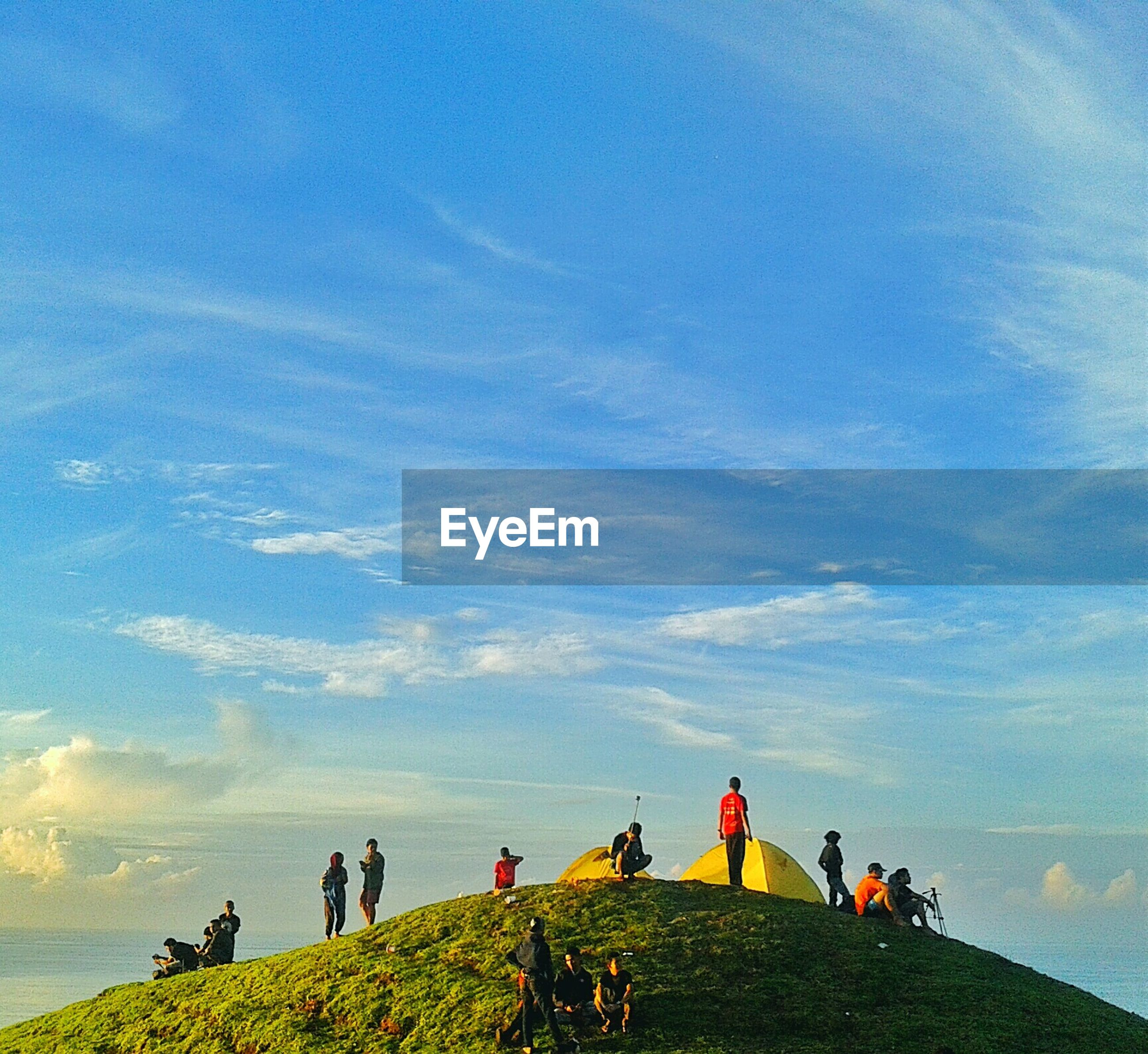 sky, large group of people, lifestyles, men, leisure activity, person, cloud - sky, mixed age range, landscape, nature, medium group of people, sitting, tranquility, togetherness, scenics, cloud, beauty in nature, tranquil scene, group of people