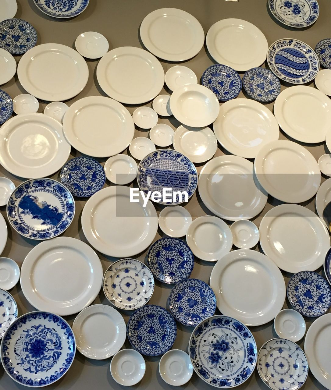 large group of objects, choice, still life, indoors, variation, no people, abundance, high angle view, white color, pattern, decoration, full frame, design, ceramics, backgrounds, bowl, collection, table, for sale, shape, crockery, luxury, floral pattern, consumerism