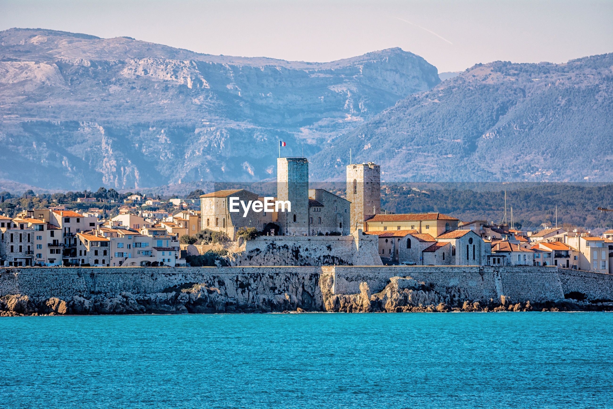 Buildings in city at waterfront, old antibes