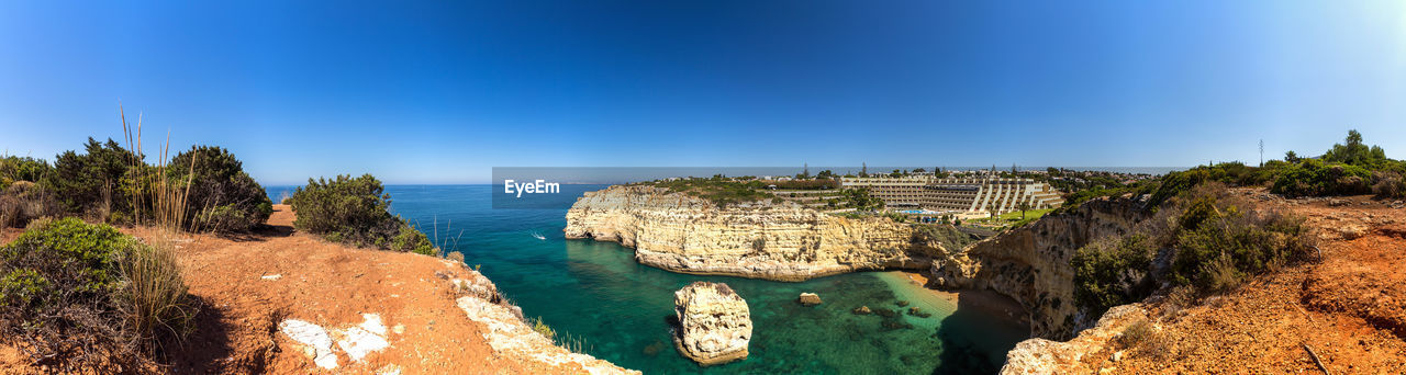 A panorama view on the Tivoli Carvoeiro Hotel in the Algarve region. The hotel is carved into the rock and offers great views. Algarve Panorama Portugal Tivoli Tivoli Carvoeiro Tivoli Hotel Carvoeiro Rocks