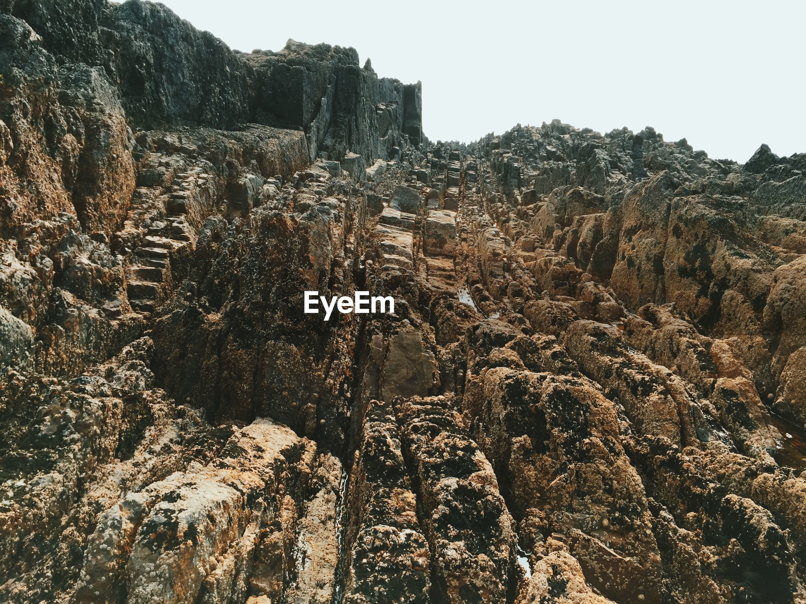 High angle view of rock formations against sky