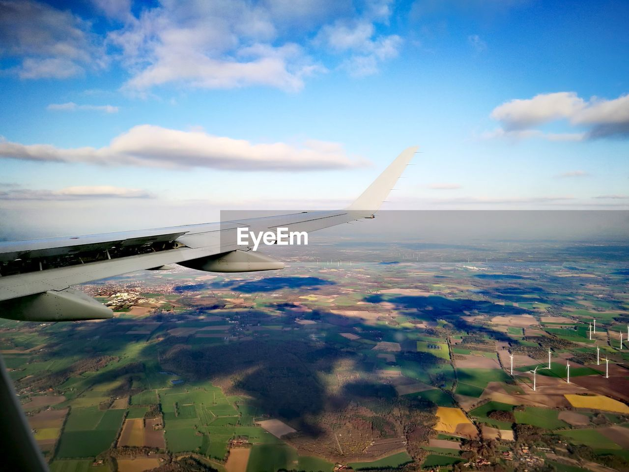 air vehicle, airplane, sky, cloud - sky, transportation, mode of transportation, flying, nature, travel, aircraft wing, day, mid-air, no people, beauty in nature, public transportation, environment, outdoors, motion, scenics - nature, on the move, plane