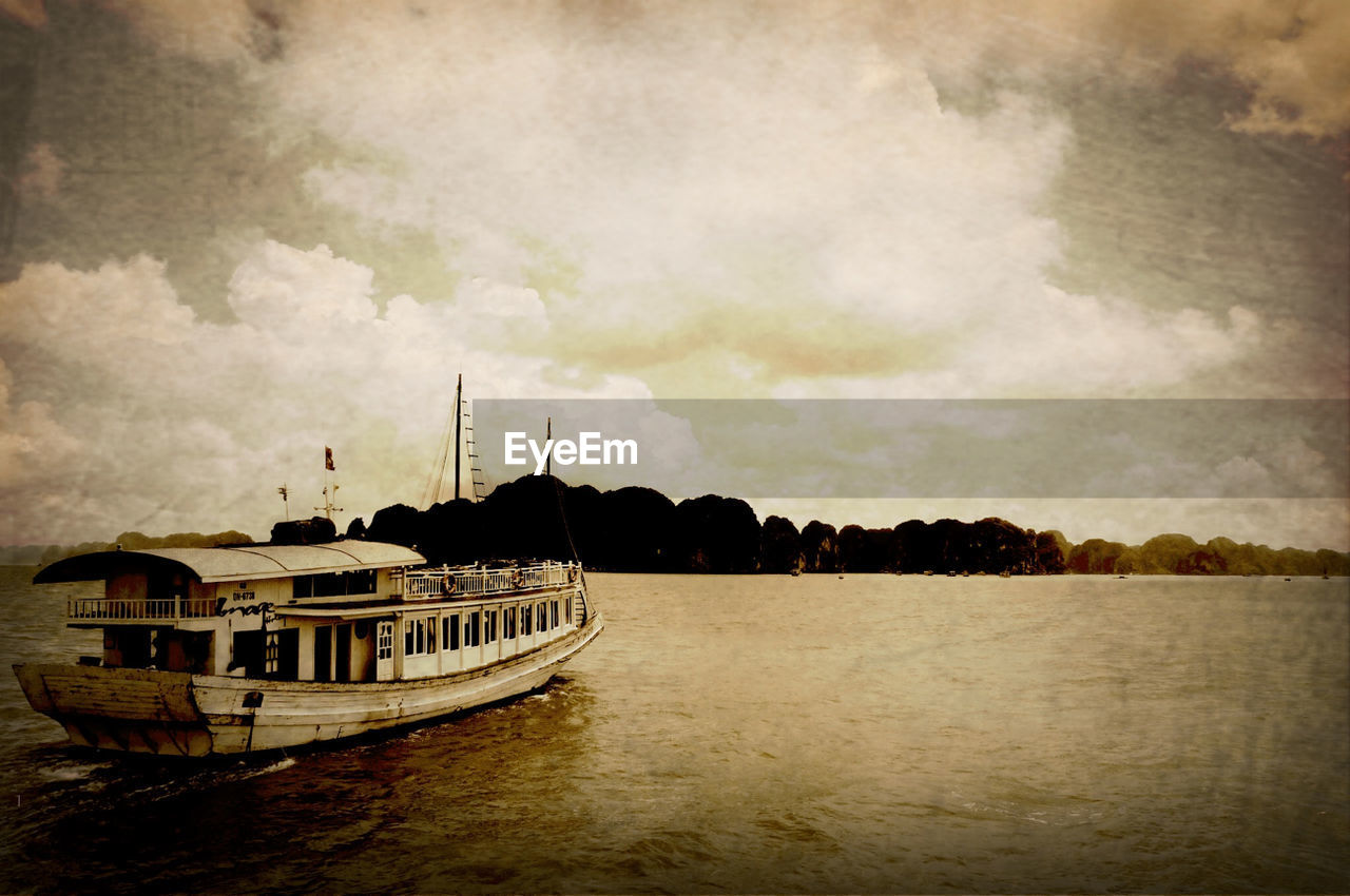 nautical vessel, transportation, water, boat, waterfront, mode of transport, sky, river, tree, no people, moored, outdoors, nature, day, beauty in nature, sailing