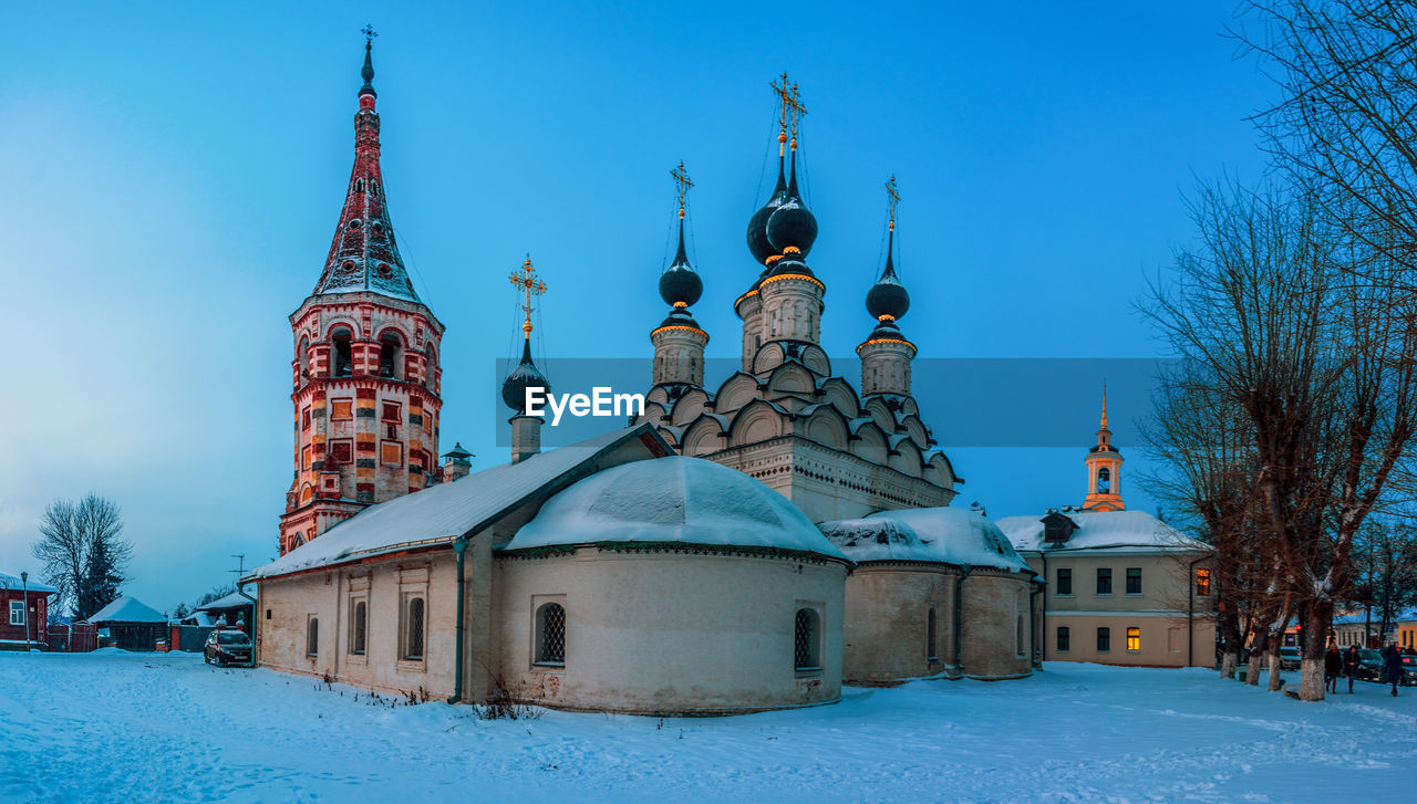 religion, place of worship, architecture, snow, spirituality, winter, built structure, cold temperature, building exterior, dome, outdoors, day, sky, bare tree, no people, travel destinations, nature, clear sky