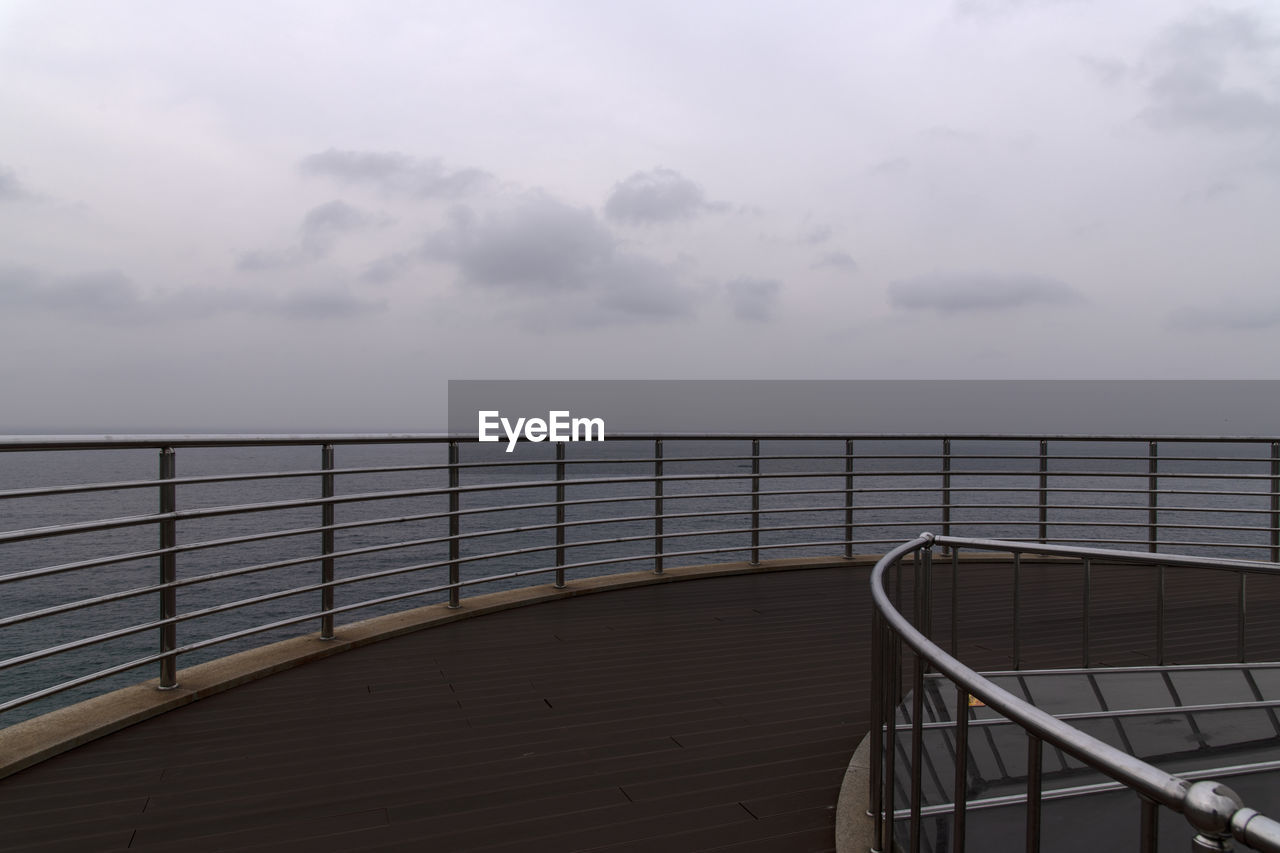 railing, sky, cloud - sky, water, no people, nature, scenics - nature, sea, beauty in nature, tranquility, tranquil scene, non-urban scene, day, horizon over water, wood - material, outdoors, absence, overcast