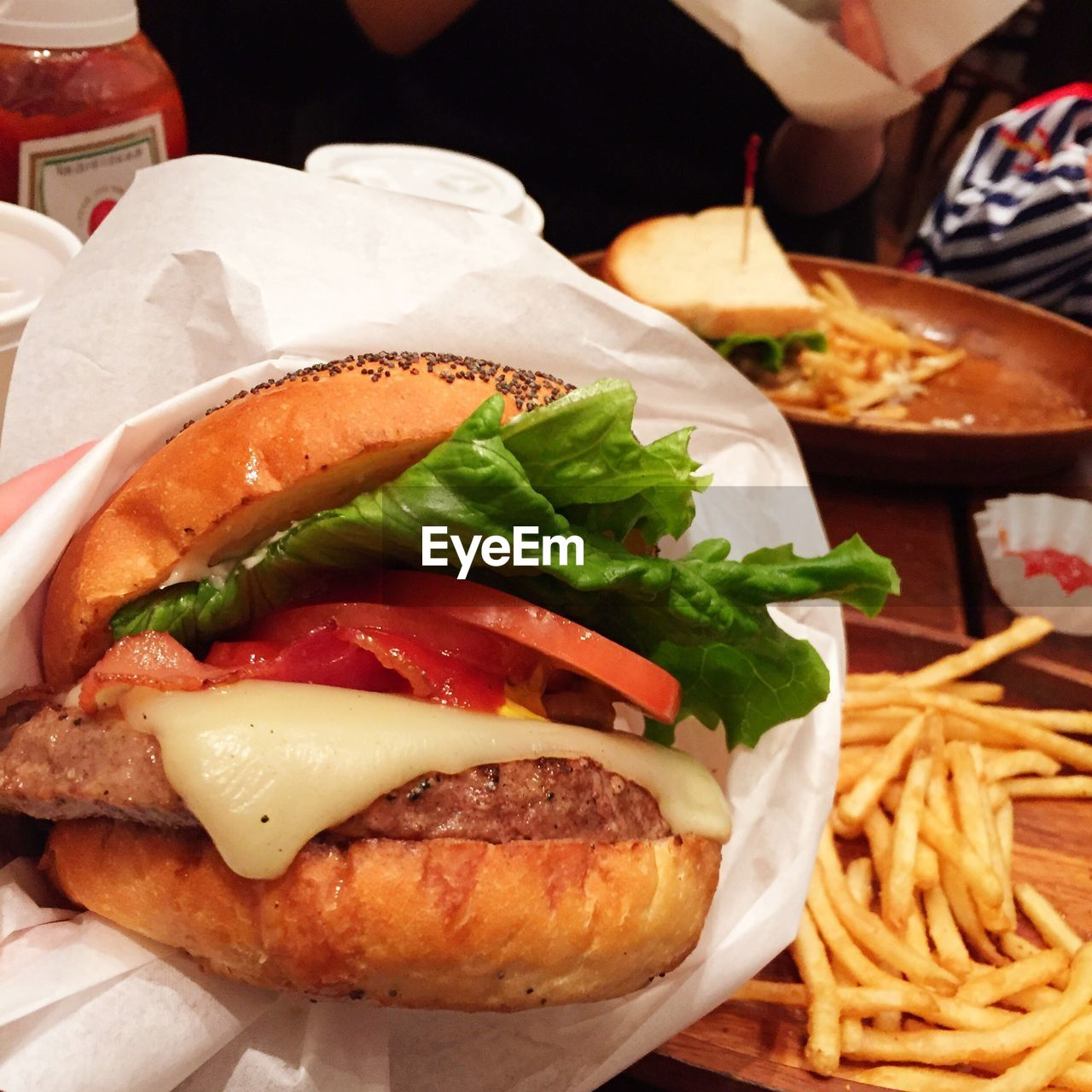 food and drink, food, burger, indoors, hamburger, freshness, ready-to-eat, serving size, unhealthy eating, bun, meat, fast food, vegetable, meal, close-up, no people, lettuce, day