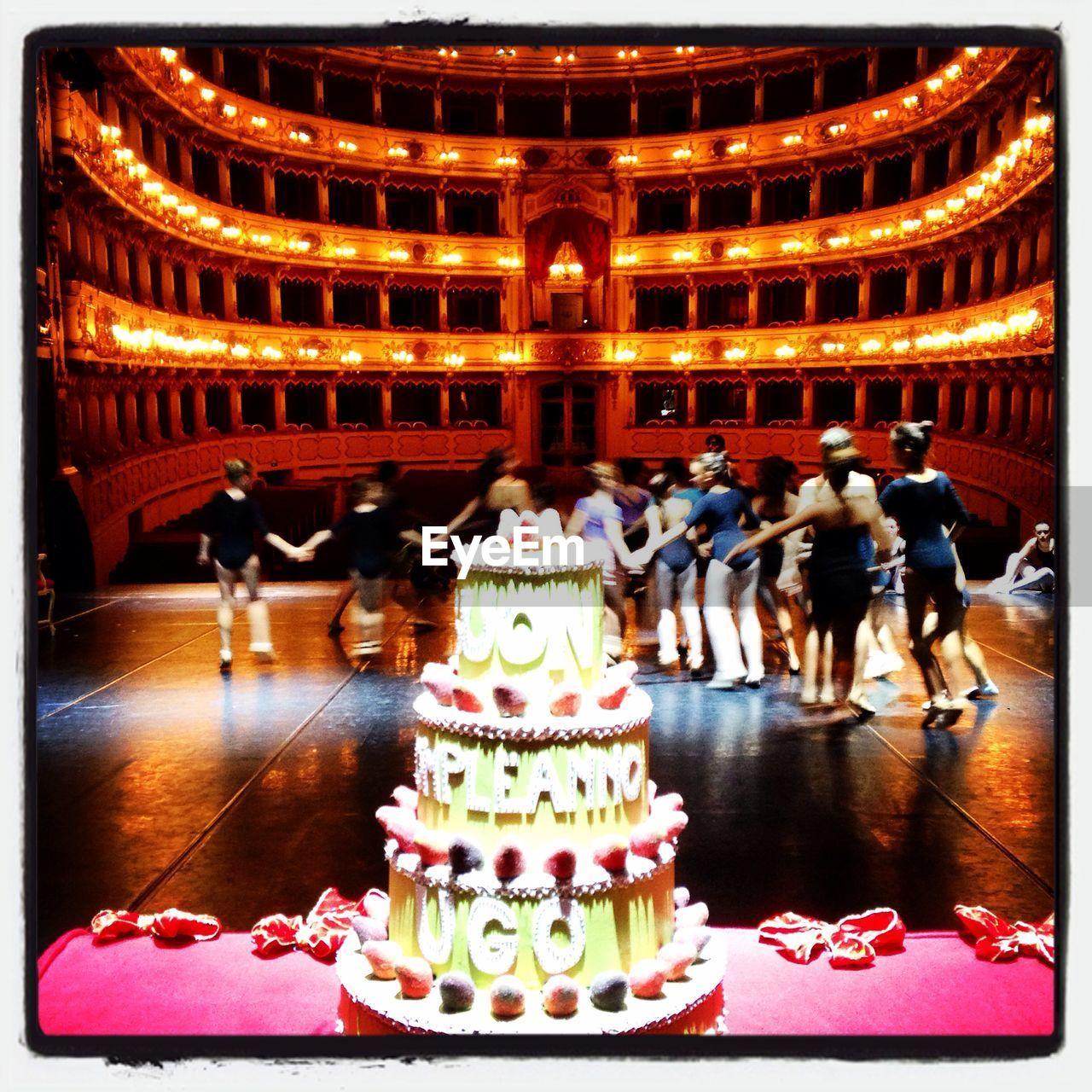 illuminated, indoors, celebration, enjoyment, sitting, large group of people, men, night, people