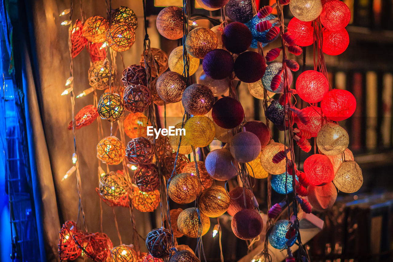 decoration, for sale, illuminated, multi colored, choice, hanging, lighting equipment, retail, variation, market, abundance, large group of objects, no people, collection, arrangement, night, retail display, business, shopping, indoors, sale, consumerism