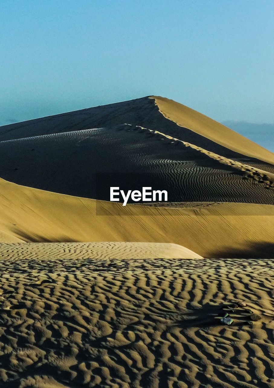 sand, sky, land, desert, scenics - nature, sand dune, clear sky, arid climate, climate, landscape, no people, day, tranquility, tranquil scene, nature, pattern, environment, sunlight, beauty in nature, non-urban scene, outdoors