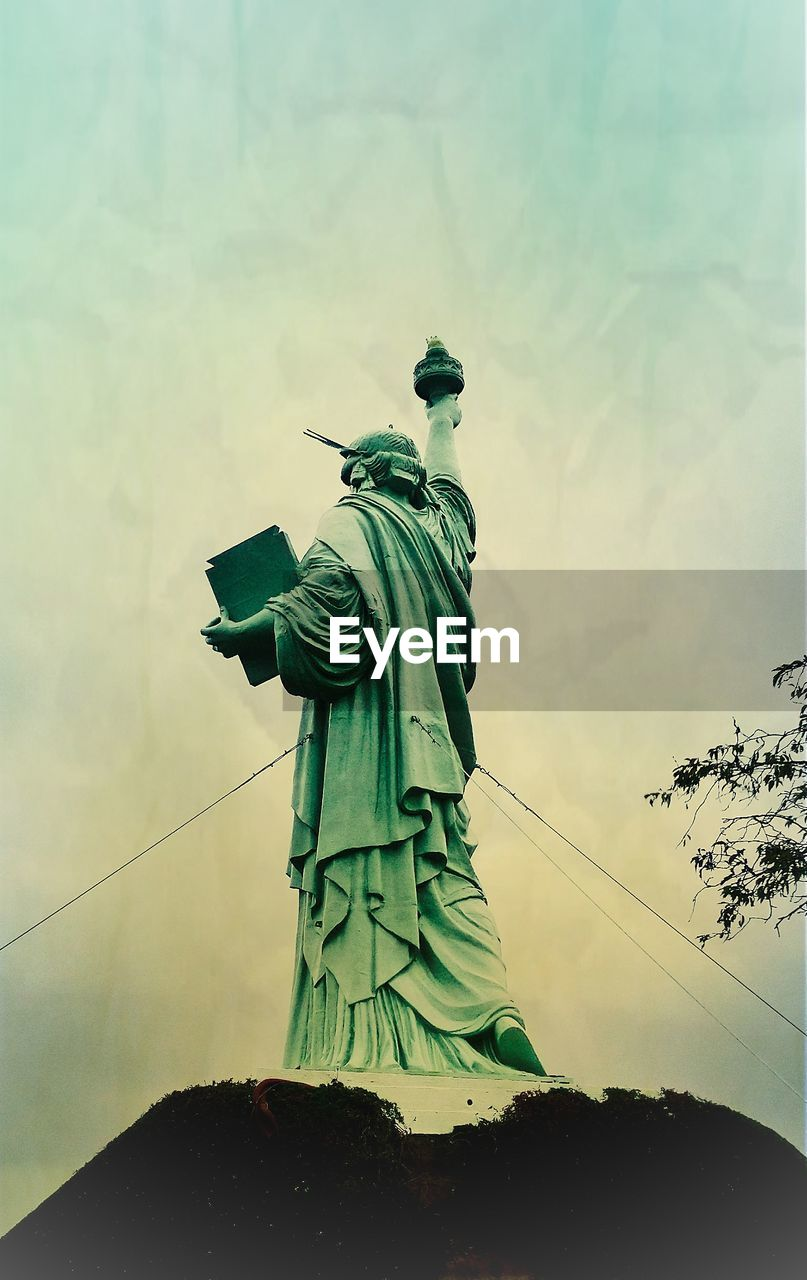 sculpture, art and craft, statue, human representation, sky, representation, low angle view, nature, creativity, no people, cloud - sky, day, craft, female likeness, male likeness, architecture, travel destinations, outdoors, travel