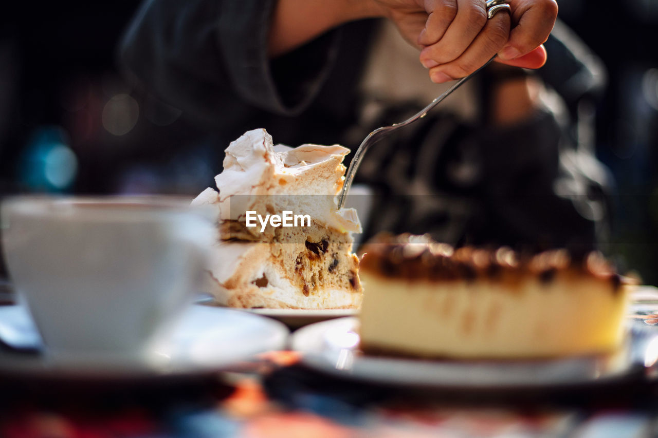 Close-up of hand eating cake