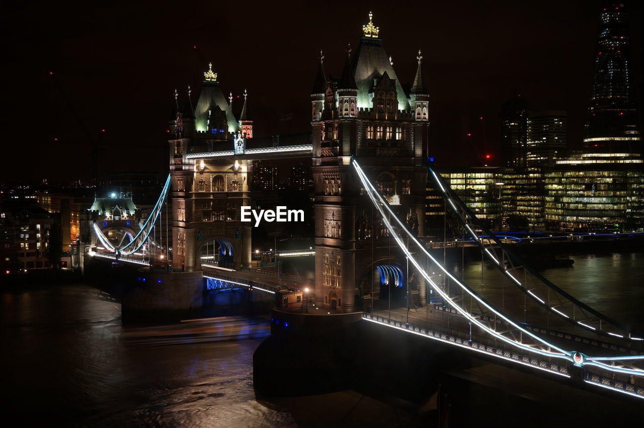 High angle view of tower bridge over river at night in city