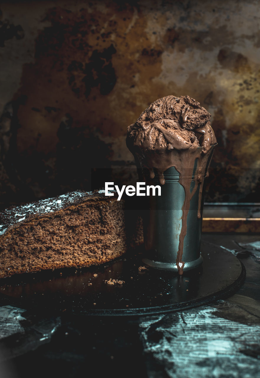 no people, focus on foreground, indoors, food and drink, sweet food, close-up, food, indulgence, freshness, still life, dessert, metal, sweet, rusty, chocolate, day, brown, water, temptation