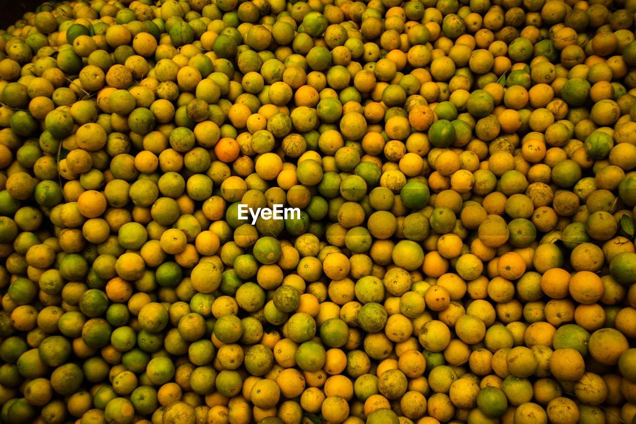 Full Frame Shot Of Orange For Sale At Market Stall