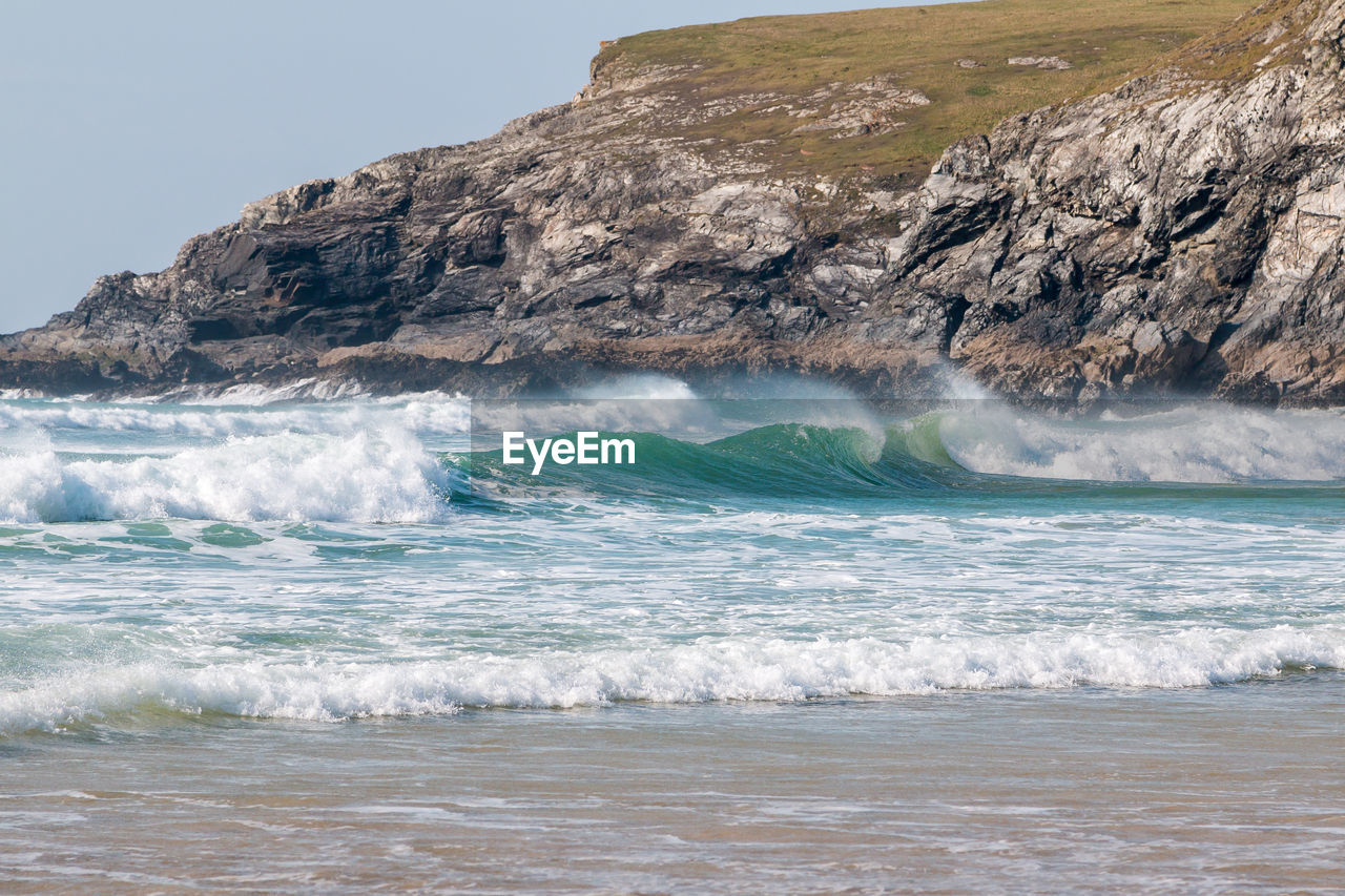 motion, sea, water, beauty in nature, scenics - nature, wave, power in nature, power, aquatic sport, rock, sport, sky, land, nature, day, surfing, beach, waterfront, outdoors, flowing water, flowing