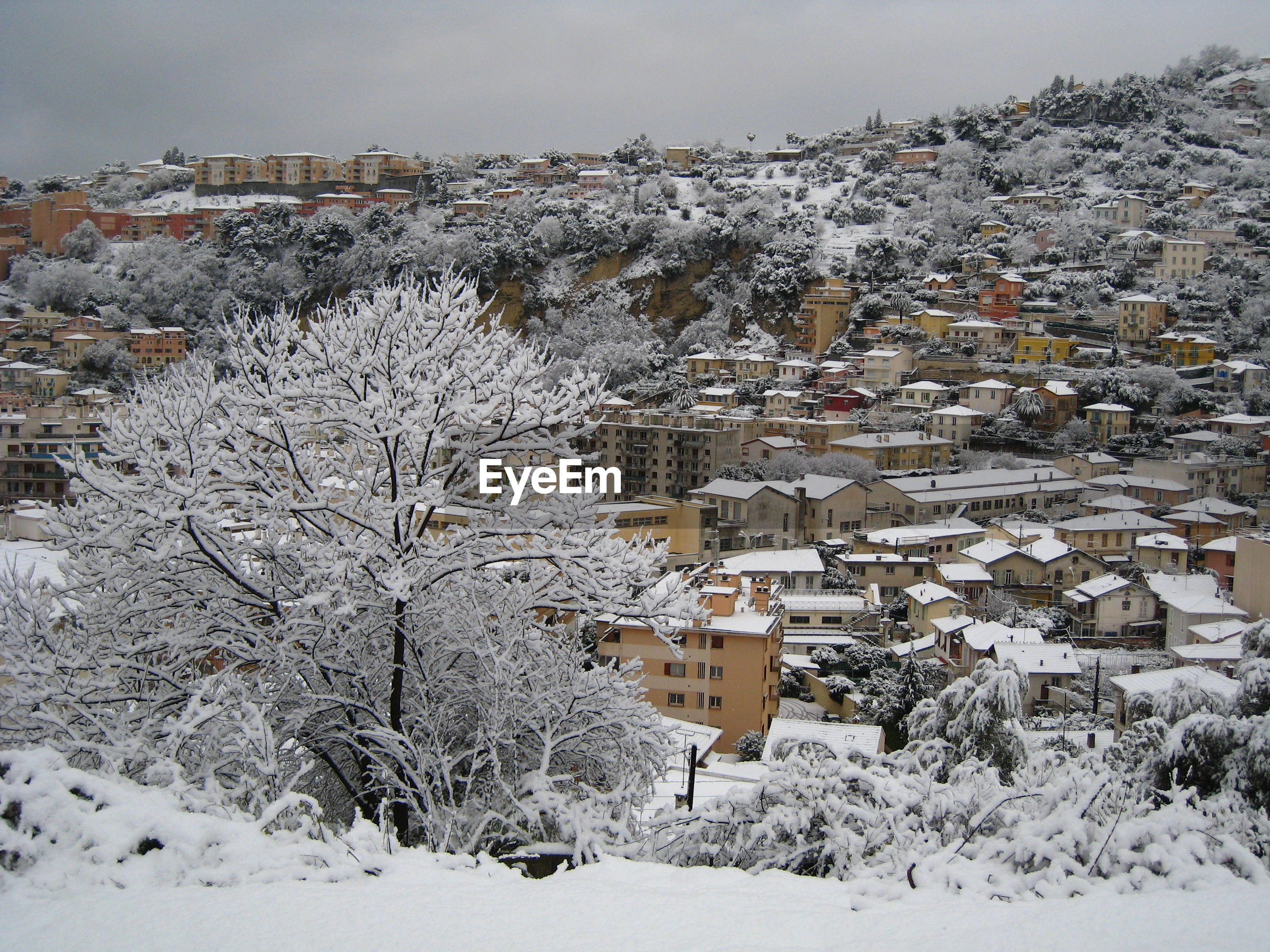 Aerial view of snow covered houses against sky