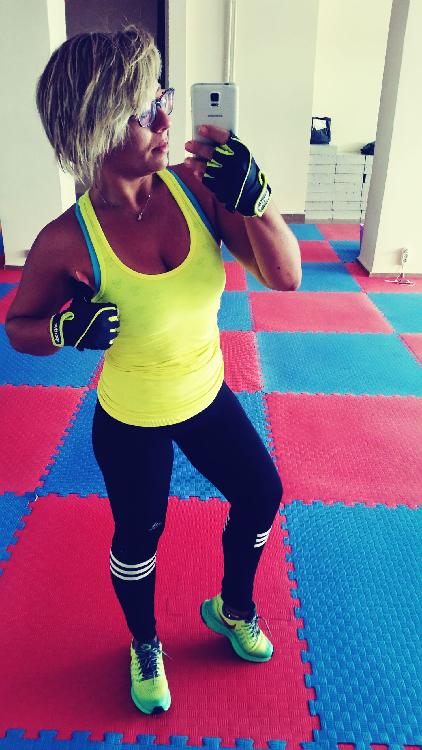 lifestyles, real people, one person, full length, leisure activity, sport, sports clothing, indoors, gym, exercising, concentration, skill, young women, healthy lifestyle, blond hair, young adult, exercise equipment, day, athlete, people