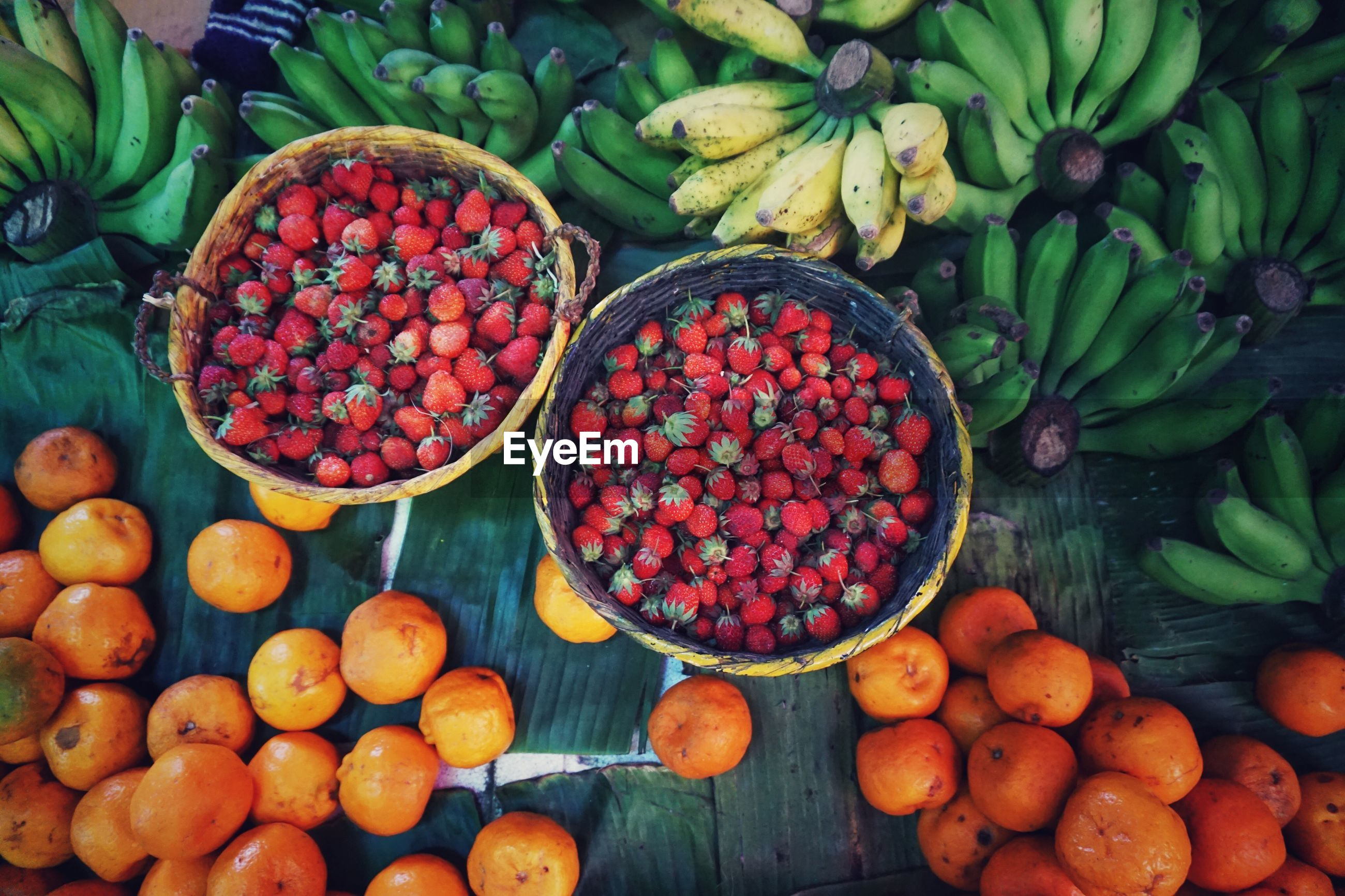 High angle view of various fruits in market for sale