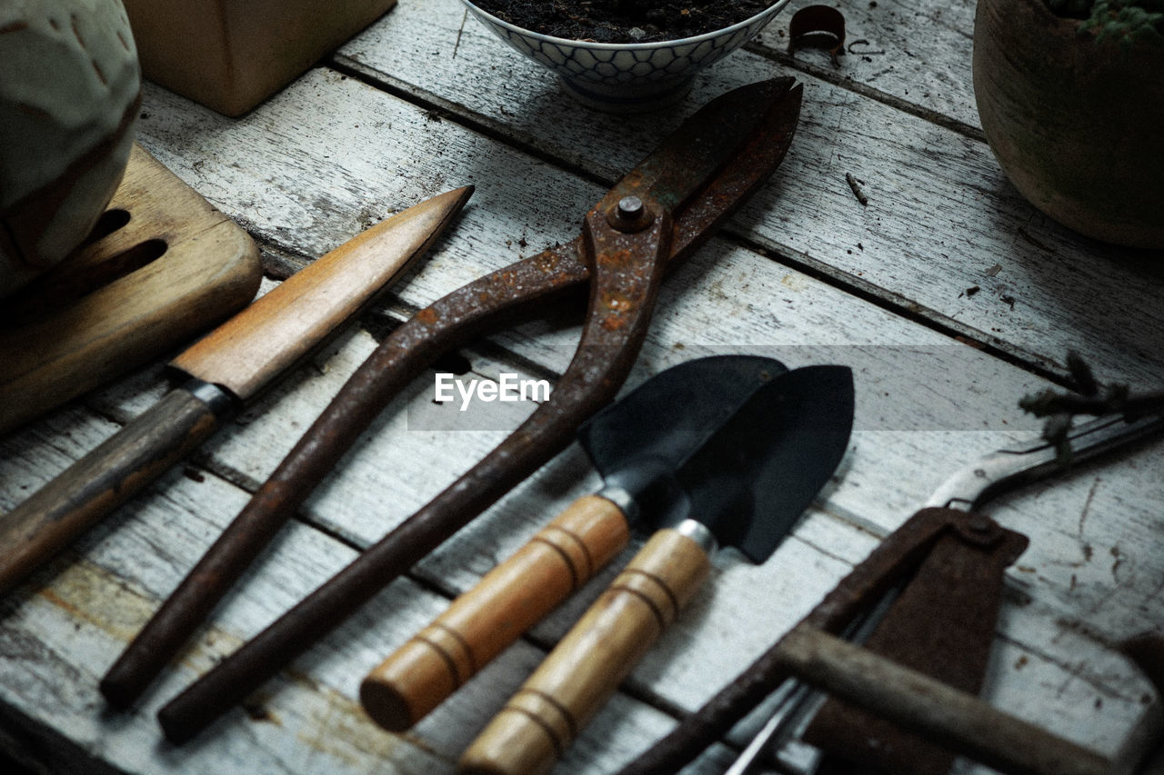 wood - material, tool, hand tool, indoors, still life, work tool, table, high angle view, no people, variation, choice, metal, equipment, old, close-up, hammer, large group of objects, pliers, group of objects, workshop, chisel