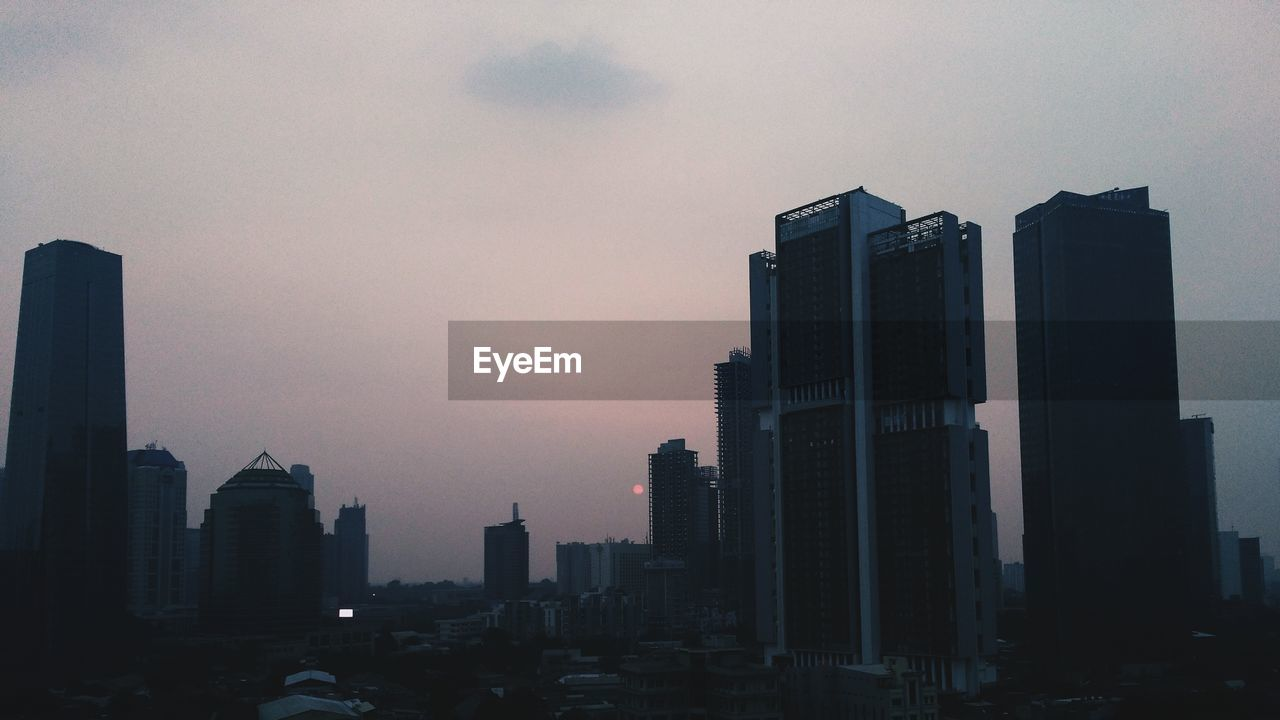 skyscraper, architecture, building exterior, city, built structure, modern, tall - high, tower, cityscape, development, travel destinations, tall, sky, downtown district, urban skyline, no people, sunset, outdoors, day