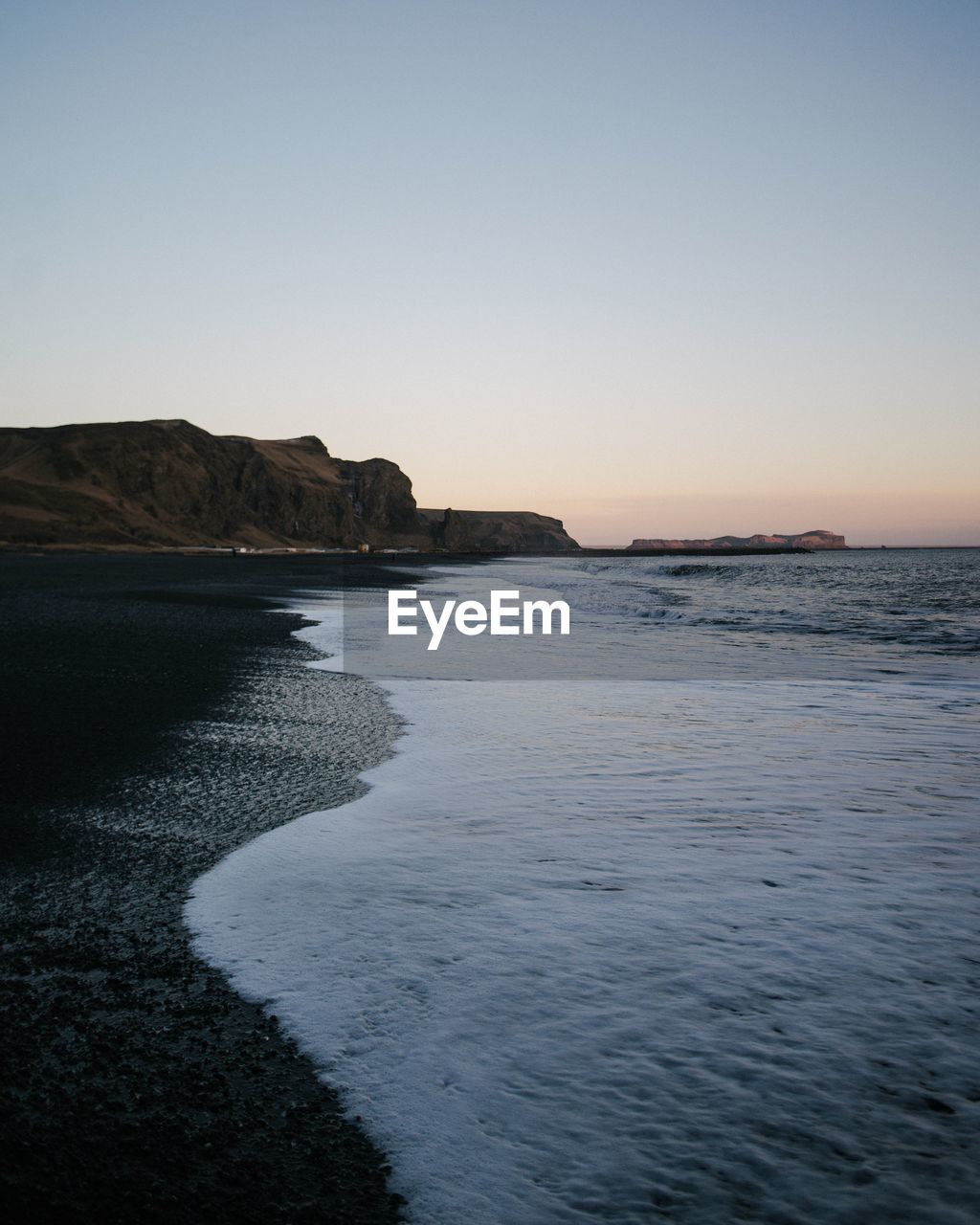 sky, sea, water, tranquility, clear sky, beauty in nature, copy space, scenics - nature, tranquil scene, rock, beach, no people, nature, land, rock - object, solid, waterfront, sunset, rock formation, outdoors
