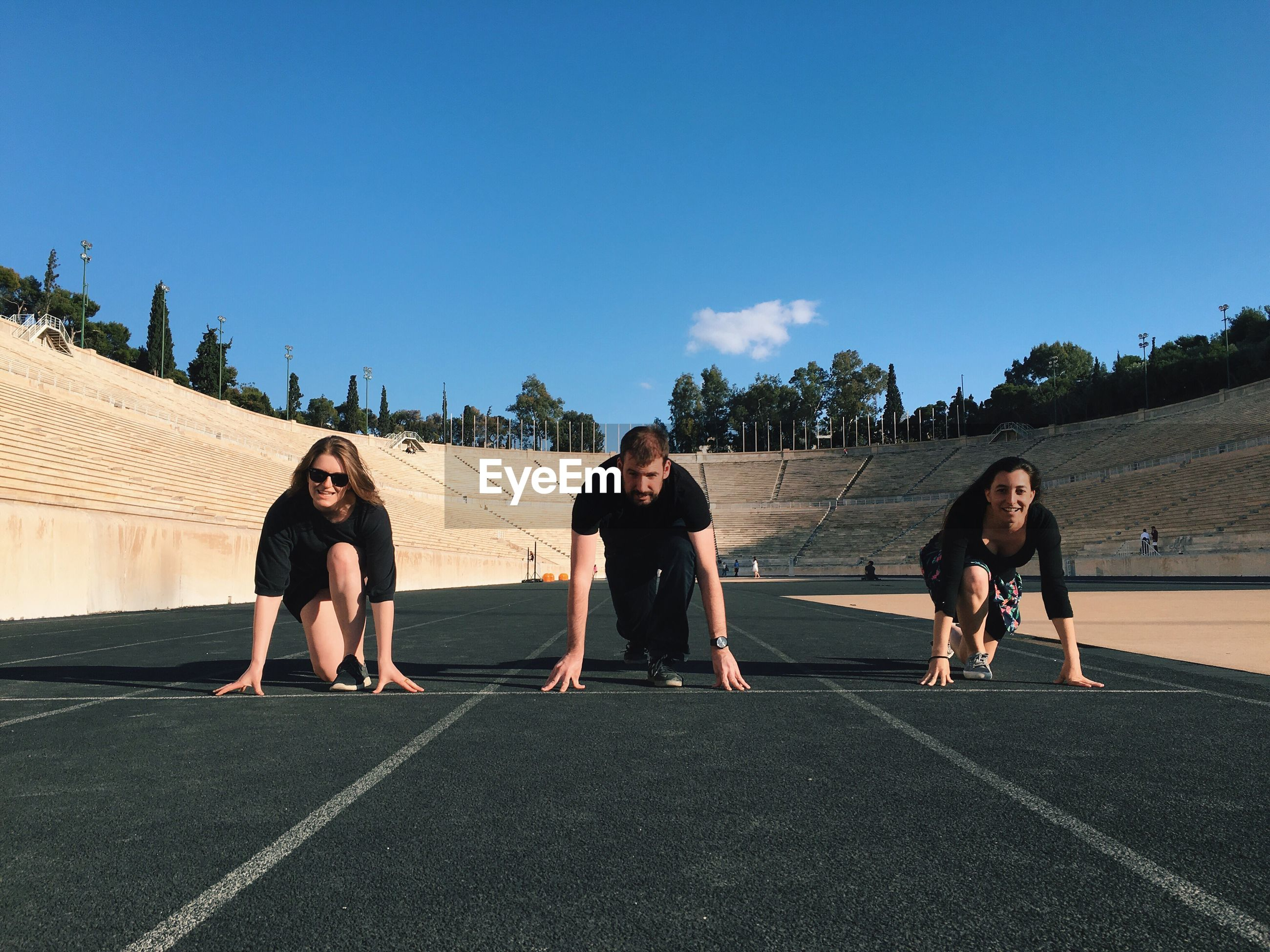 Friends poised on track at panathinaiko stadium