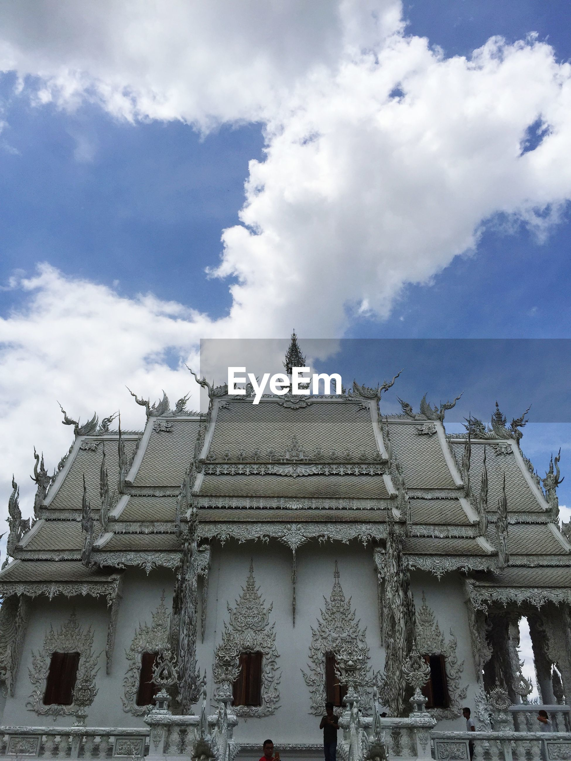 Low angle view of wat rong khun against sky