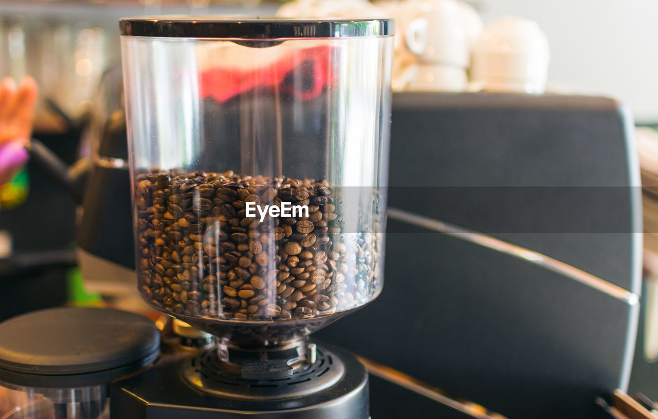 Close-Up Of Coffee Beans In Machine