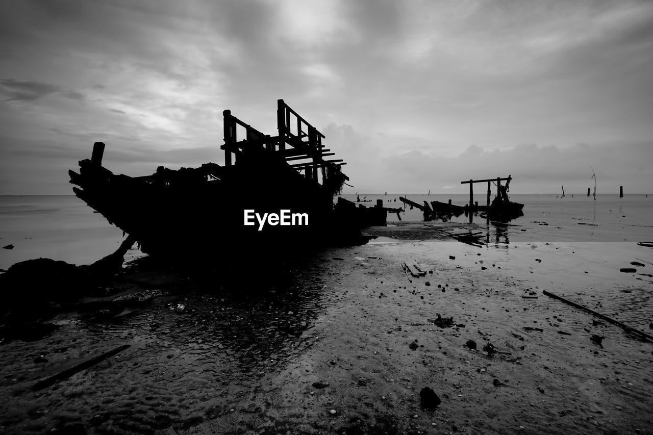 sky, nautical vessel, cloud - sky, mode of transportation, transportation, water, sea, nature, ship, land, beach, no people, tranquil scene, scenics - nature, beauty in nature, tranquility, sunset, outdoors, deterioration, fishing boat