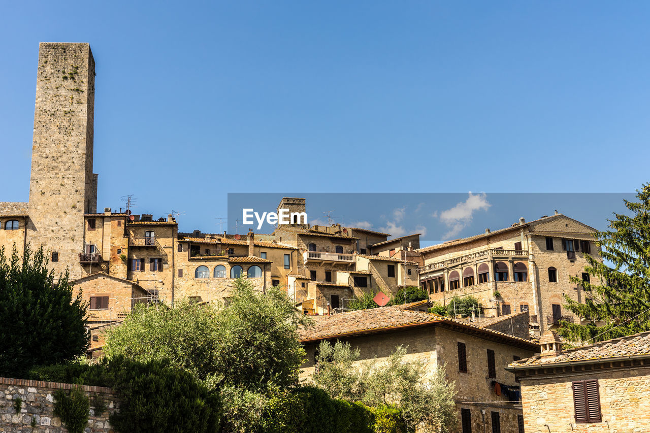 architecture, built structure, sky, building exterior, plant, tree, nature, building, low angle view, the past, history, day, blue, no people, sunlight, copy space, clear sky, outdoors, residential district, ancient, ancient civilization