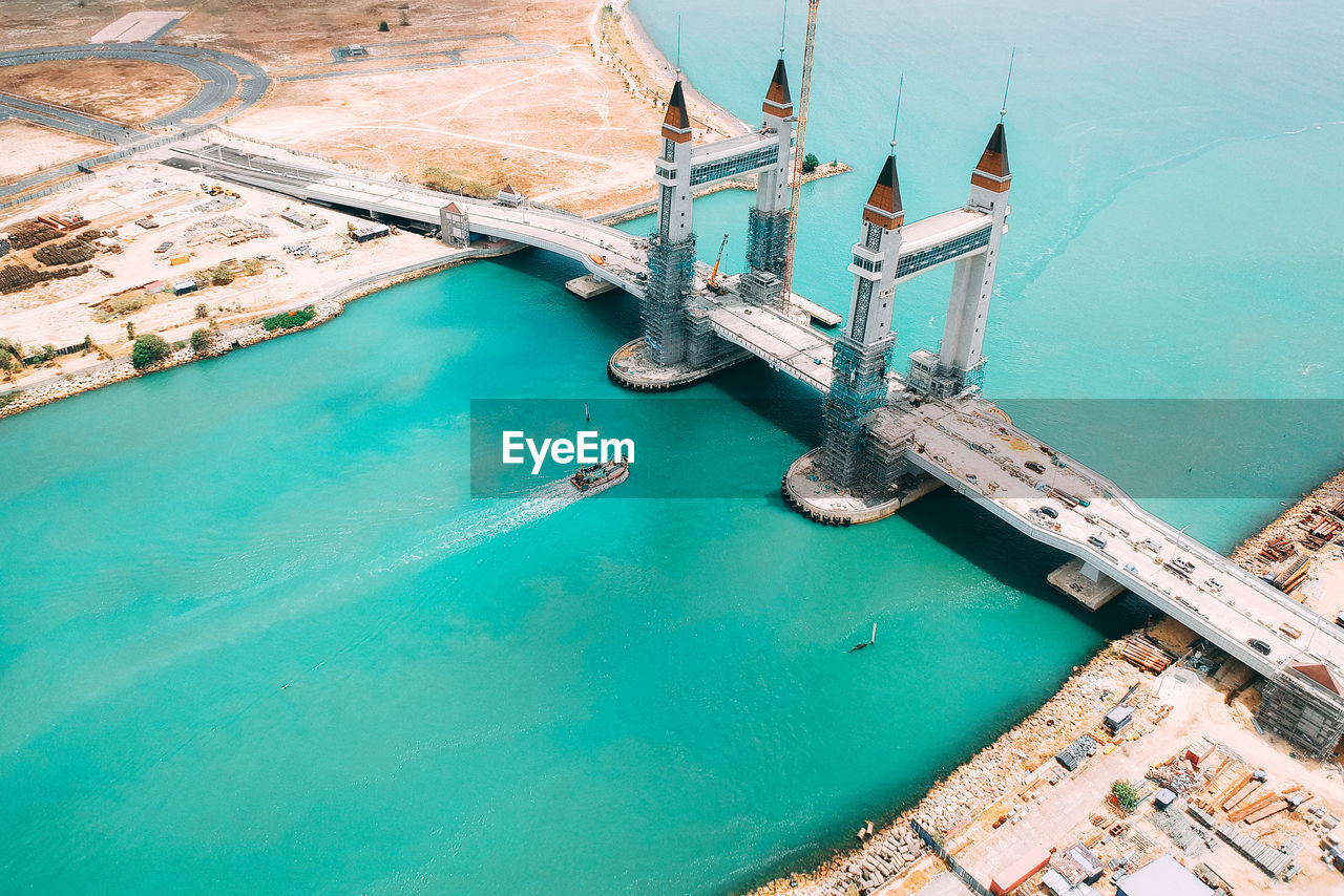 water, high angle view, sea, transportation, nature, turquoise colored, day, nautical vessel, architecture, no people, outdoors, built structure, aerial view, travel, travel destinations, blue, mode of transportation, sunlight, ship