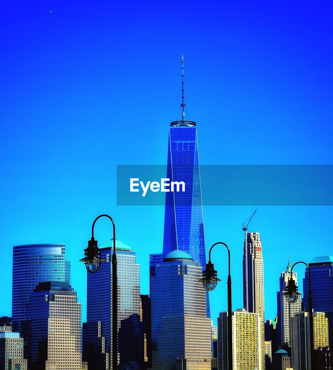 architecture, built structure, building exterior, blue, sky, office building exterior, skyscraper, building, tower, tall - high, city, clear sky, office, modern, travel destinations, nature, cityscape, no people, urban skyline, financial district, spire, outdoors