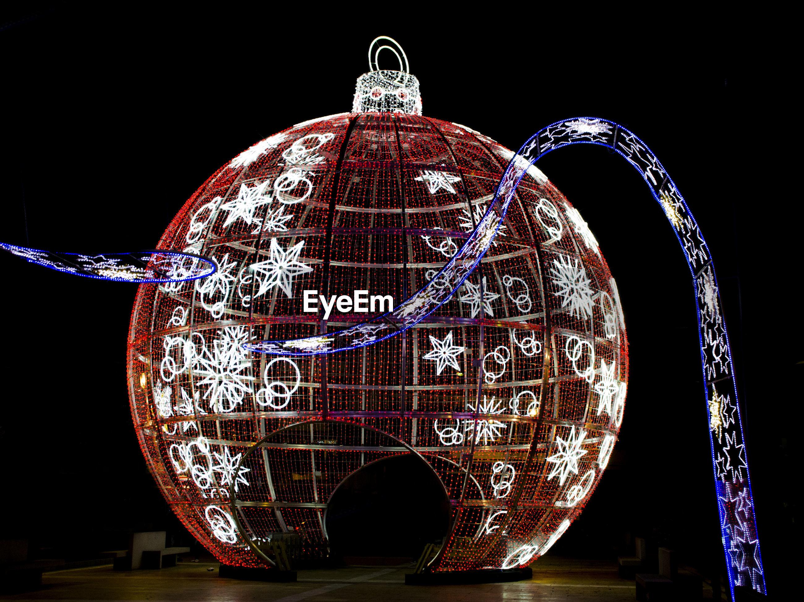 Close-up of illuminated christmas ornament at night