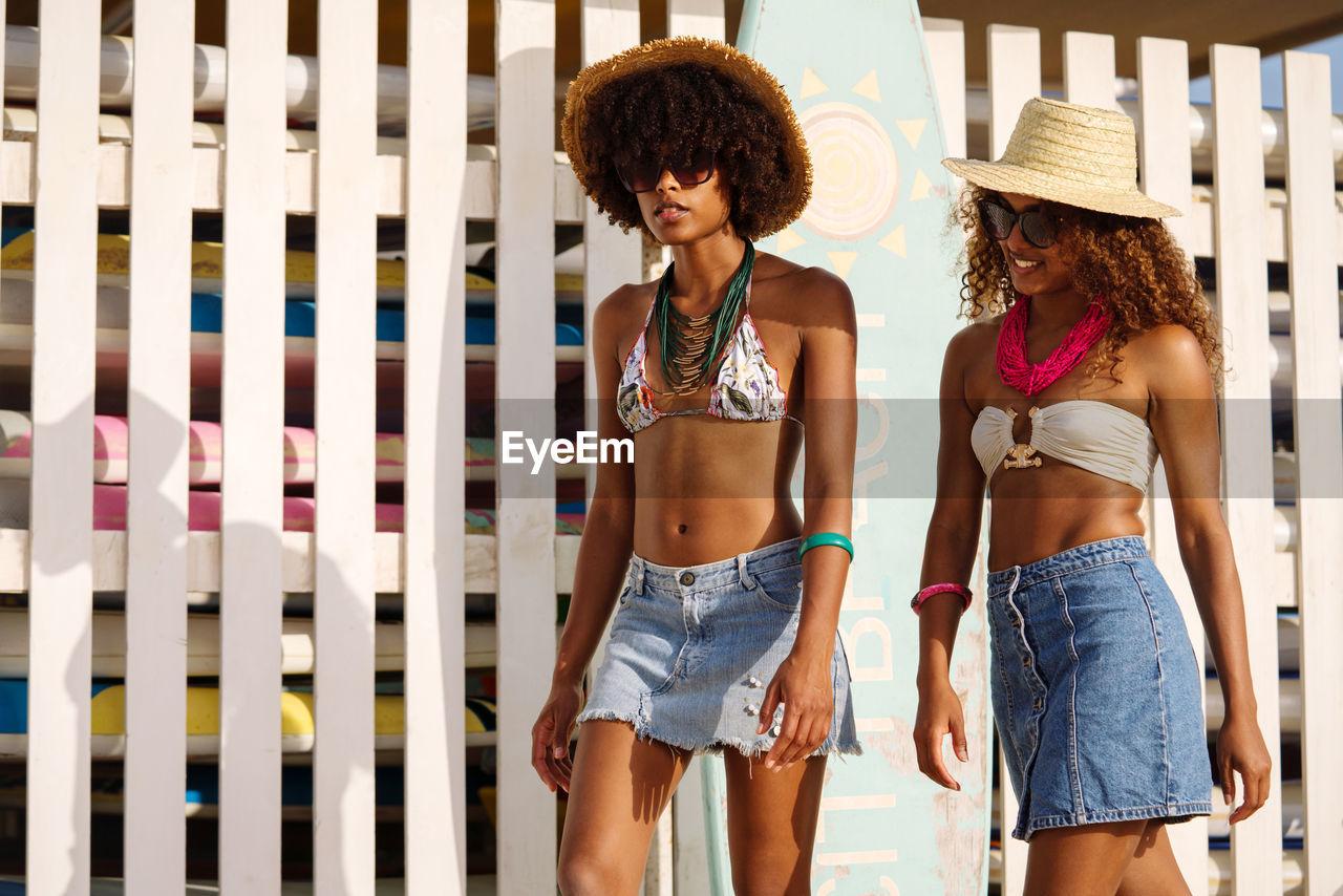 Two young black women having fun by the beach